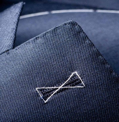 Basted Lapels - This famous lapel is created by attaching the canvas to the lapels (by hand) with a degree of tension so that the lapel rolls gently toward the break point.