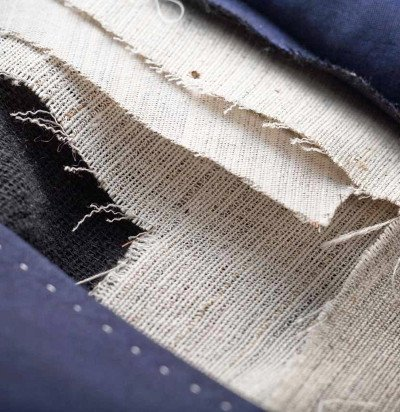 Canvas Interlining - In all our handmade jackets, we use various layers of canvas interwoven with horsehair. This ensures that the front piece of the jacket molds to fit the shape of the body after it has been worn a few times…and that the shape maintains its integrity with absolutely no fusing or gluing.
