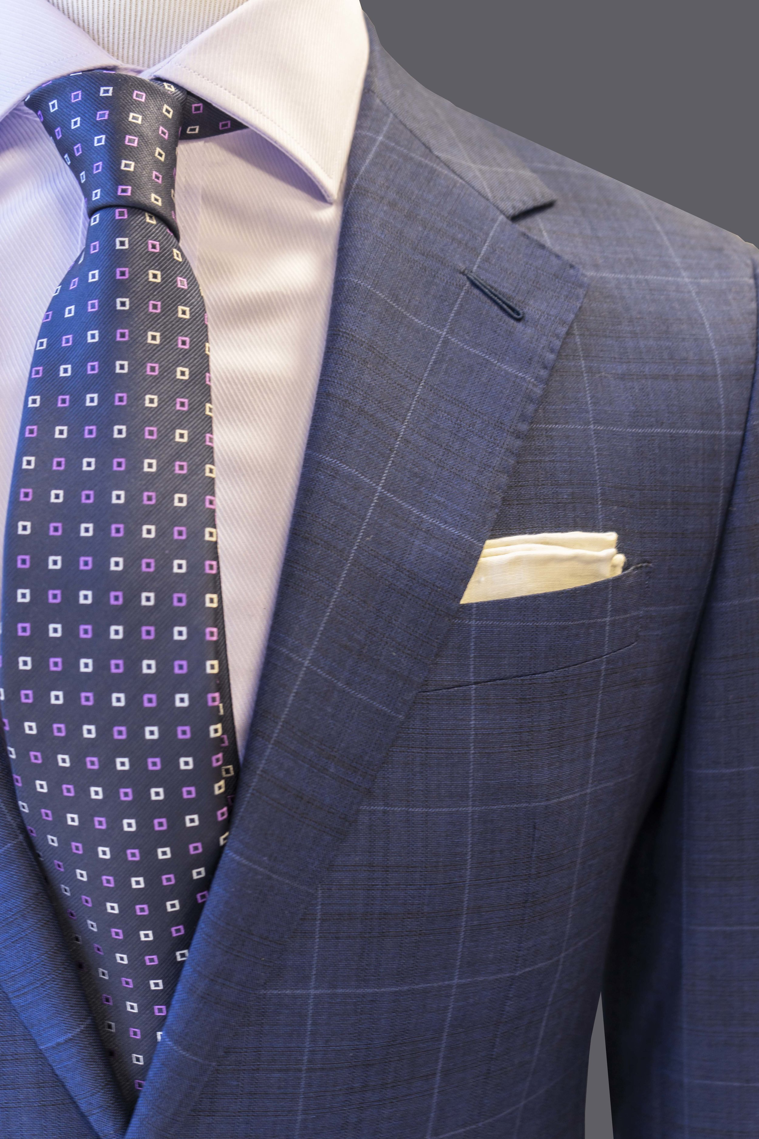 Soft, natural shoulder  and  welt breast pocket  on all of our ready made suits and tuxedos.  Classic notch lapel  and  hand-sewn Milanese buttonhole  on all suits.