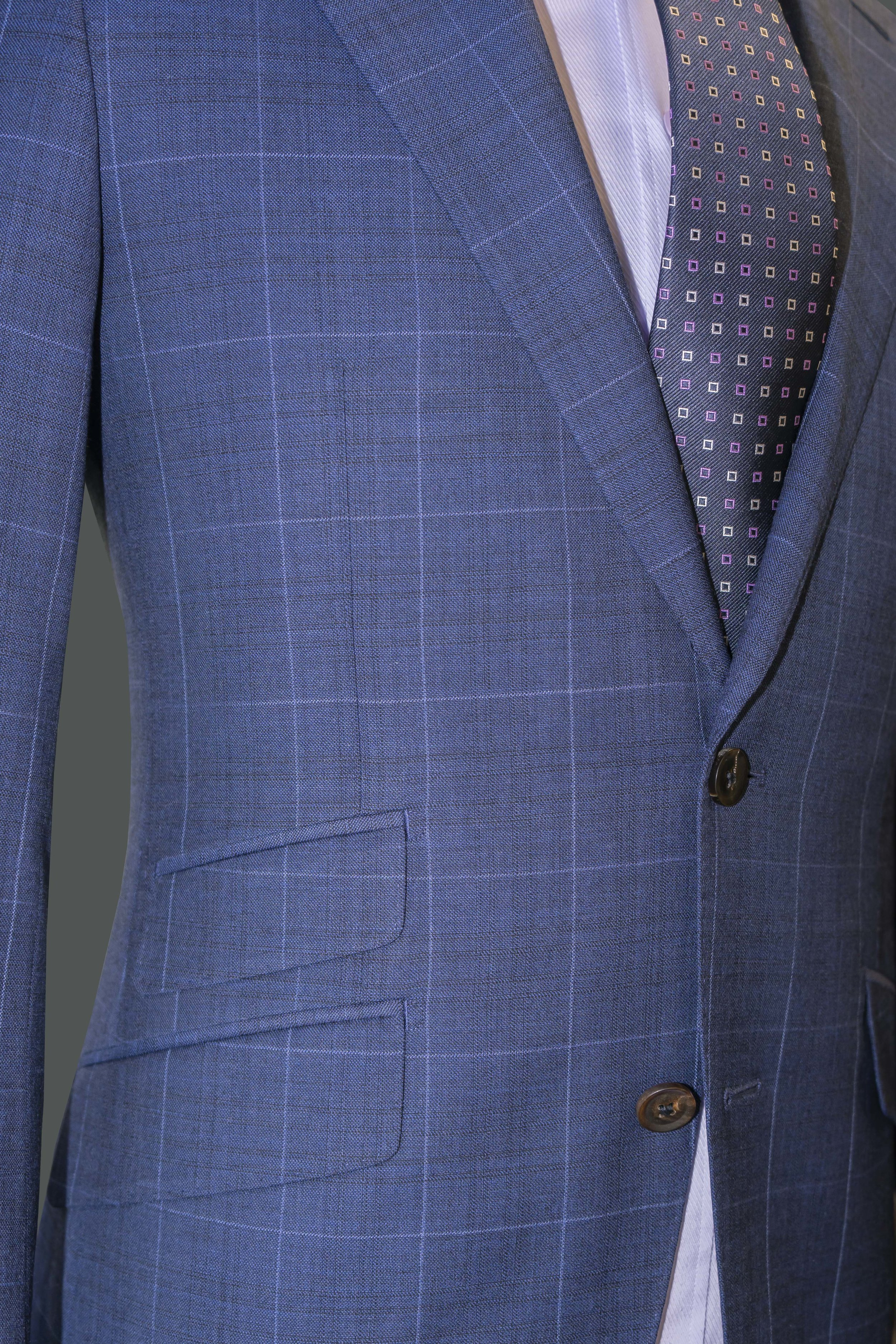 Ticket pocket  available on our Blue Plaid Suit and Admiral Blue Special Occasion Suit. Flattering  cutaway jacket opening  on all garments.