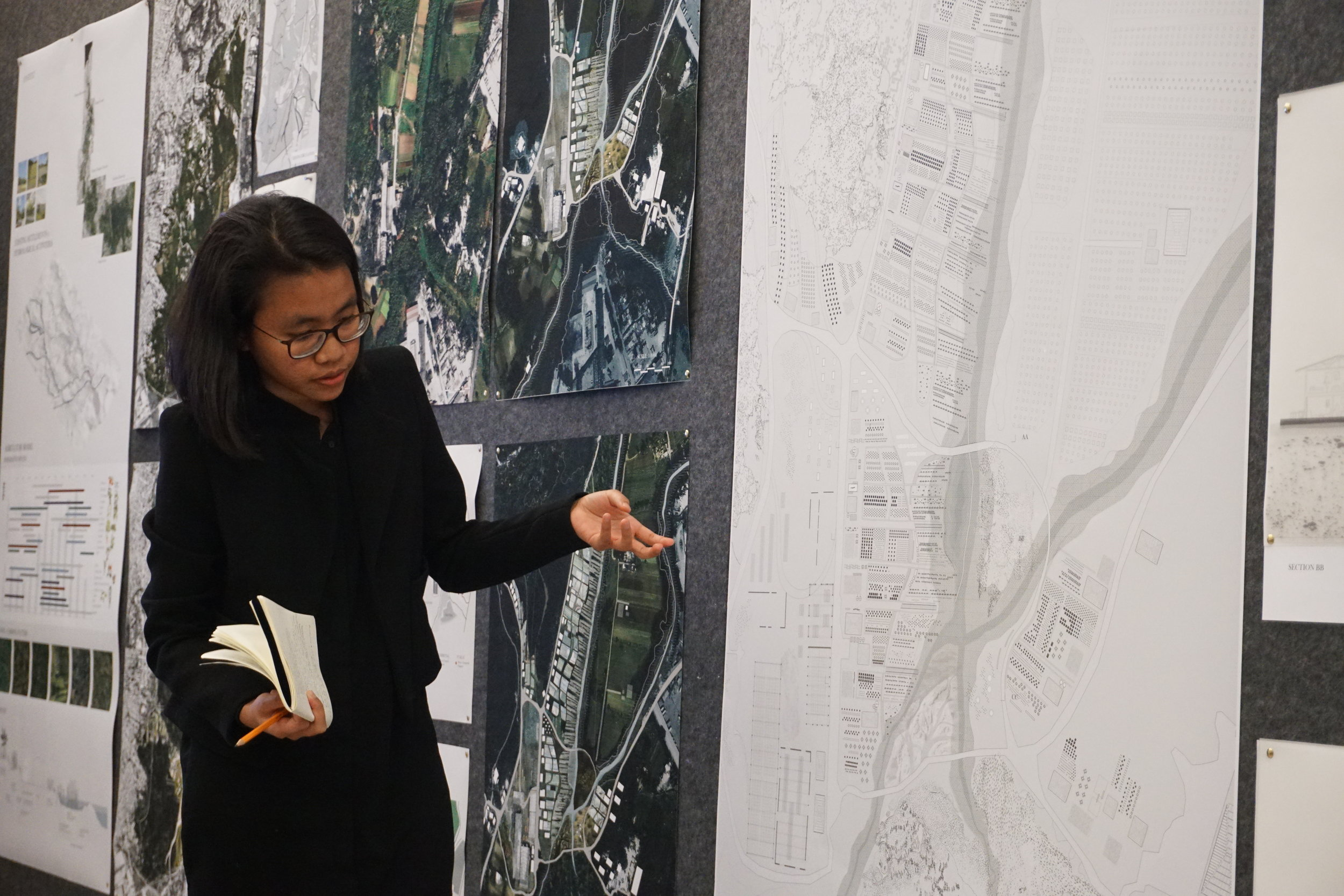 Thanh at a studio final review, 2017