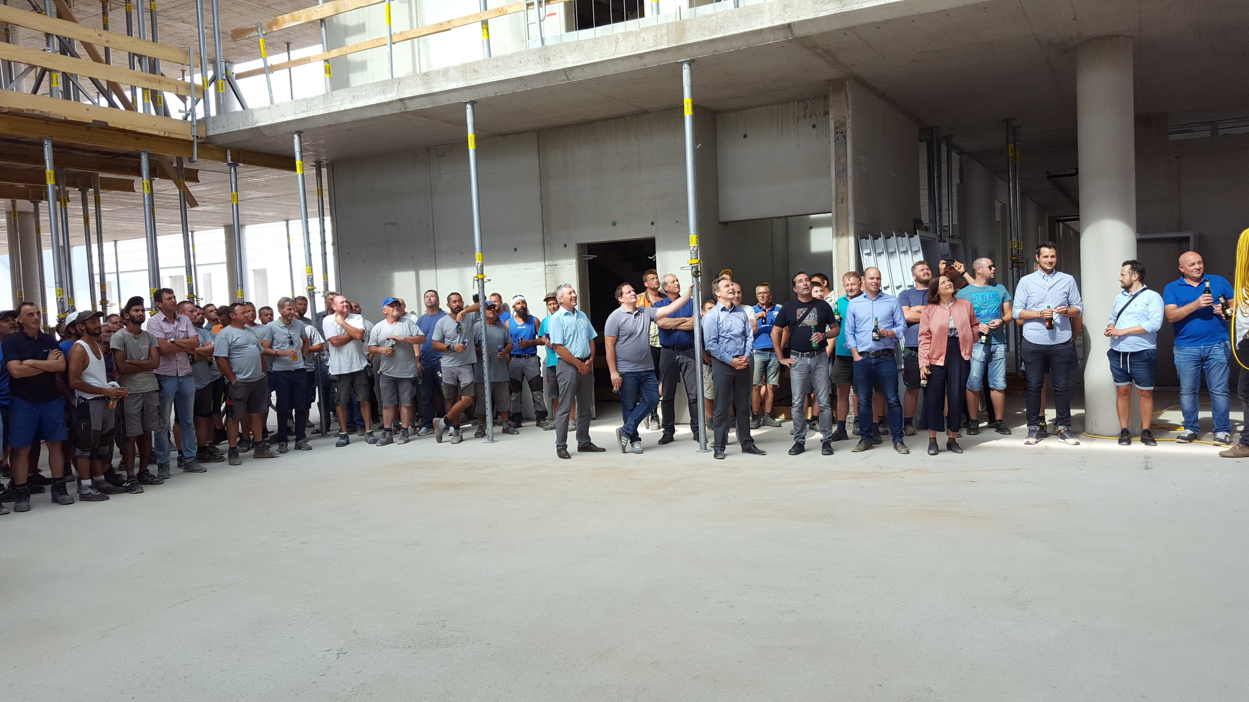 Bika at the topping out ceremony of the factory building she designed with Some Place, 2018