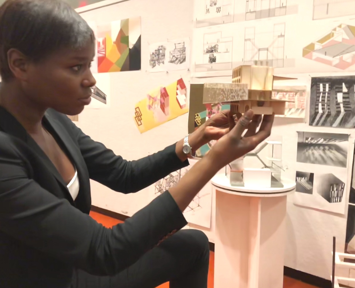 Amina reviewing one of her first year M.Arch student's models, final review, Yale School of Architecture, 2017
