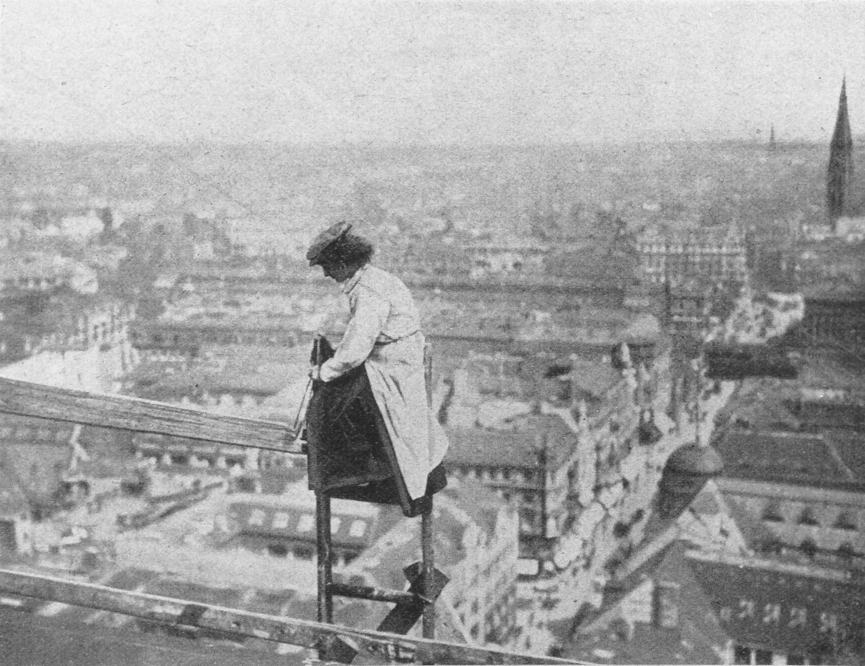 A woman builder making repairs to the roof of Berlin's city hall, 1910.