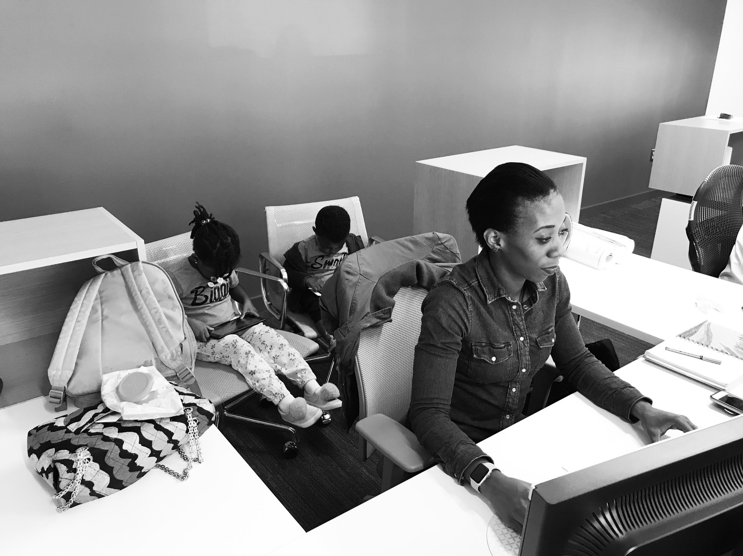 Bola and her kids at work