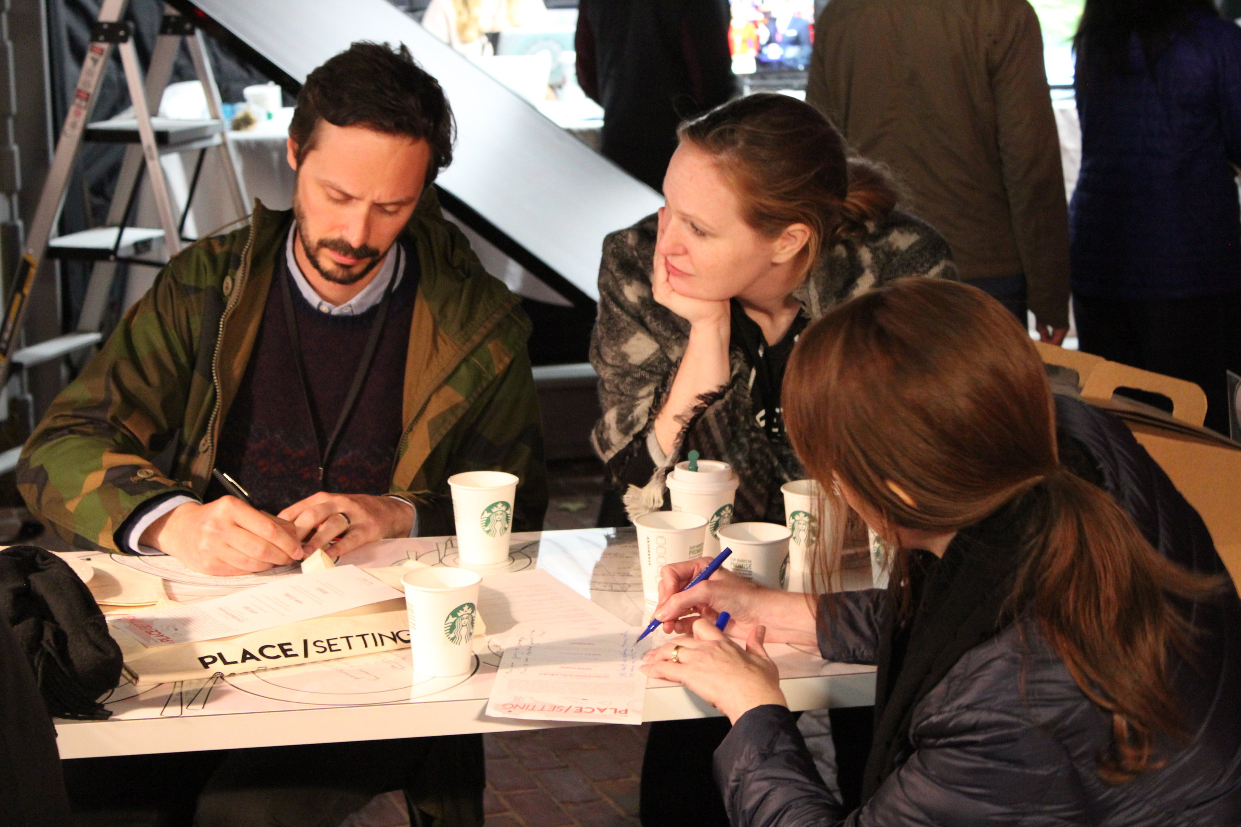 Place/Setting team (l to r: collaborator Gabriel Mugar of IDEO, Anda French, Jenny French) taking notes at a Place/Setting dinner at Hubweek, Boston, 2017
