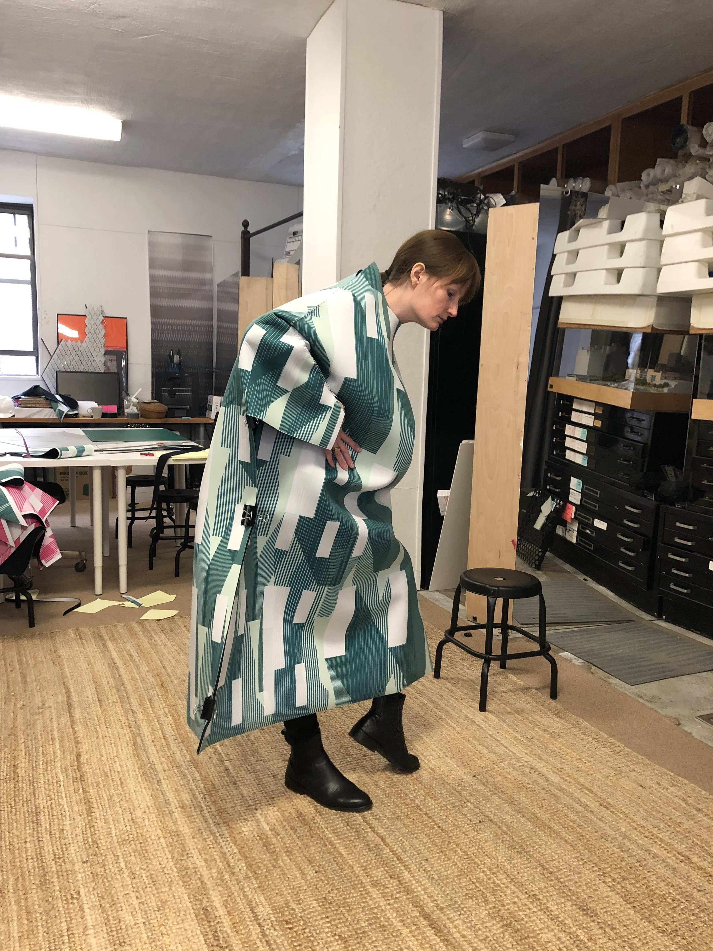 Jenny French modeling the Kendall Garage dress in mid-production at French 2D's studio