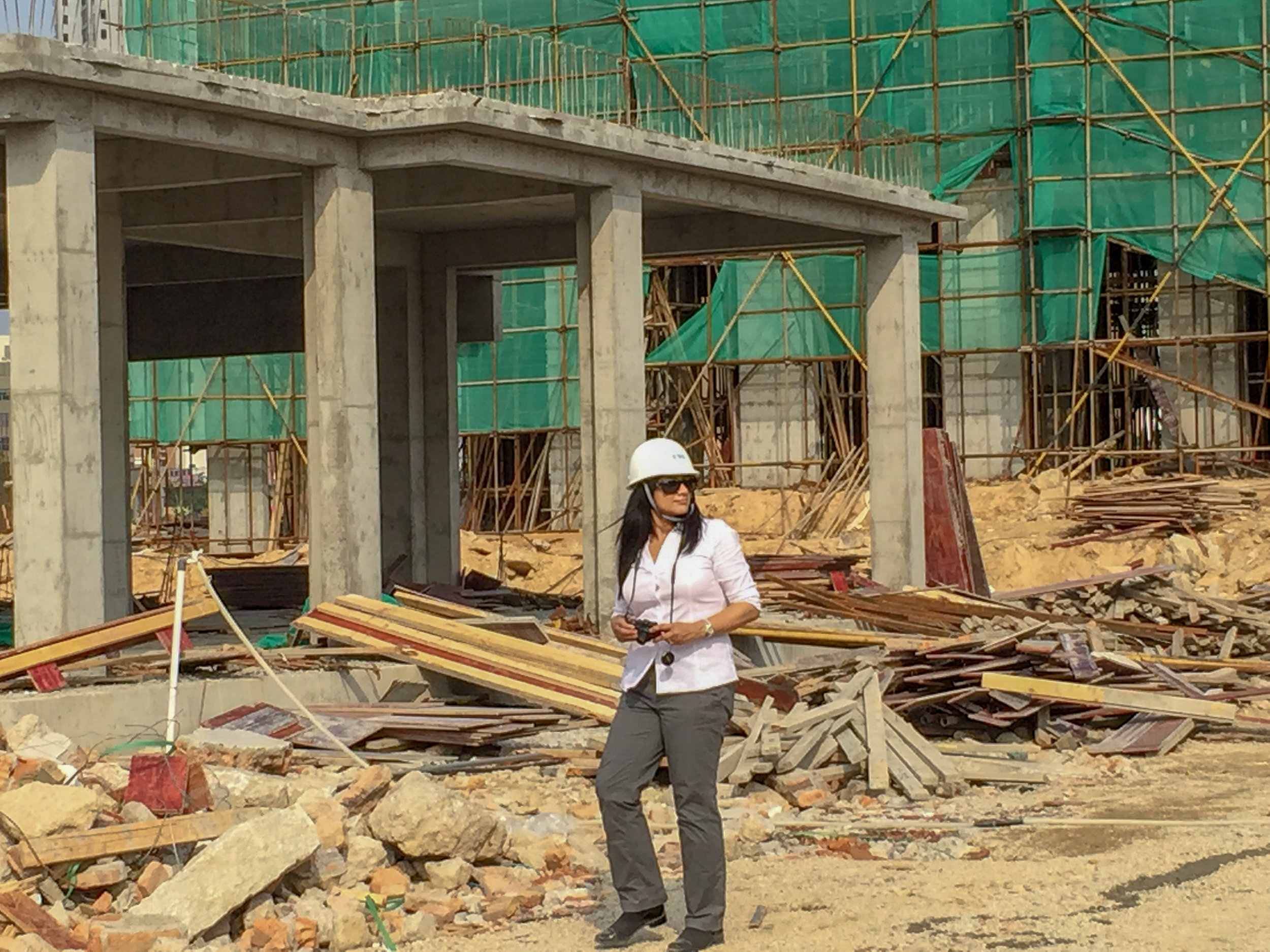 Walking a project site during construction in China.