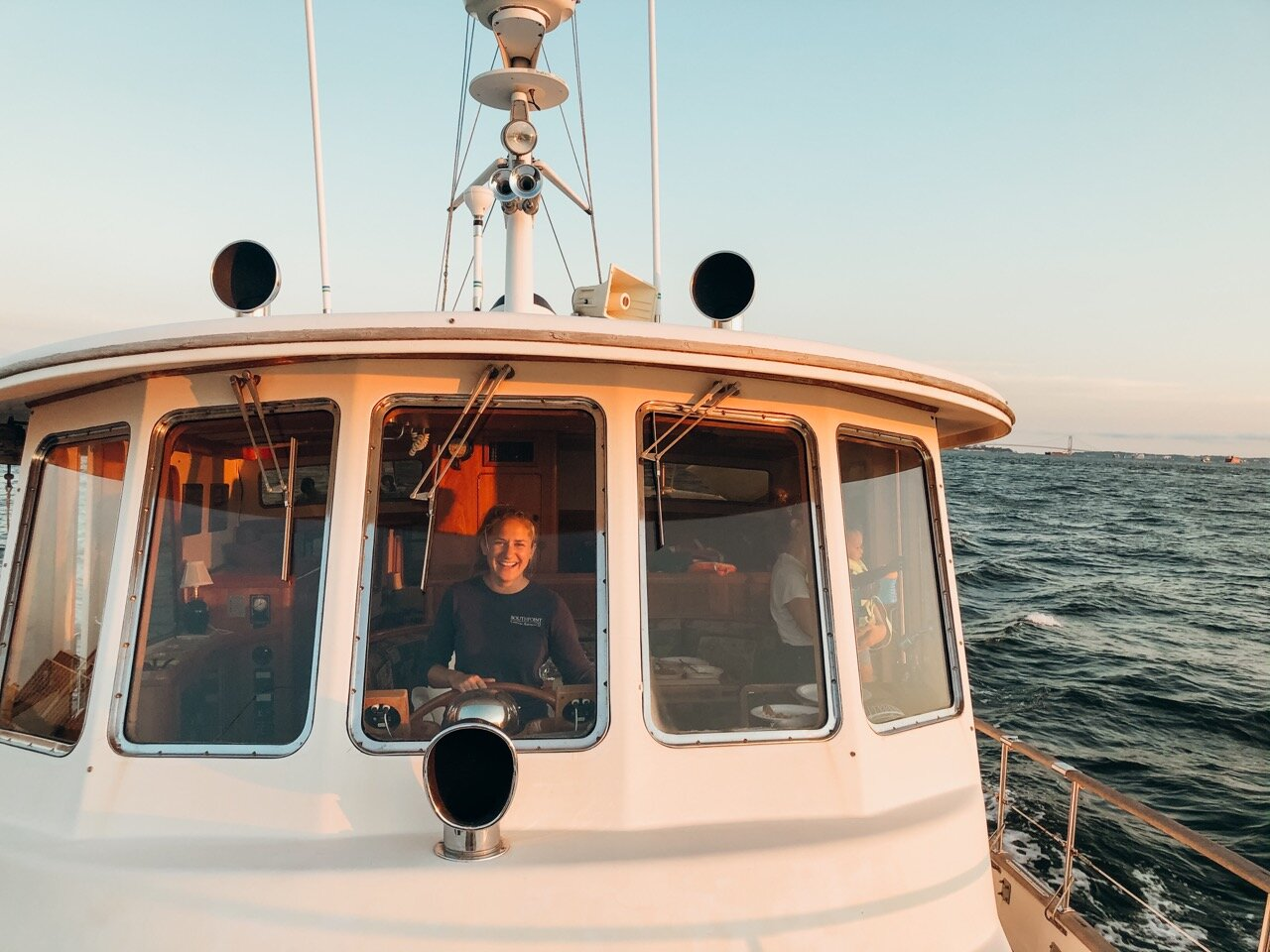 Piloting her boat during an afternoon cruise in the New York Harbor.