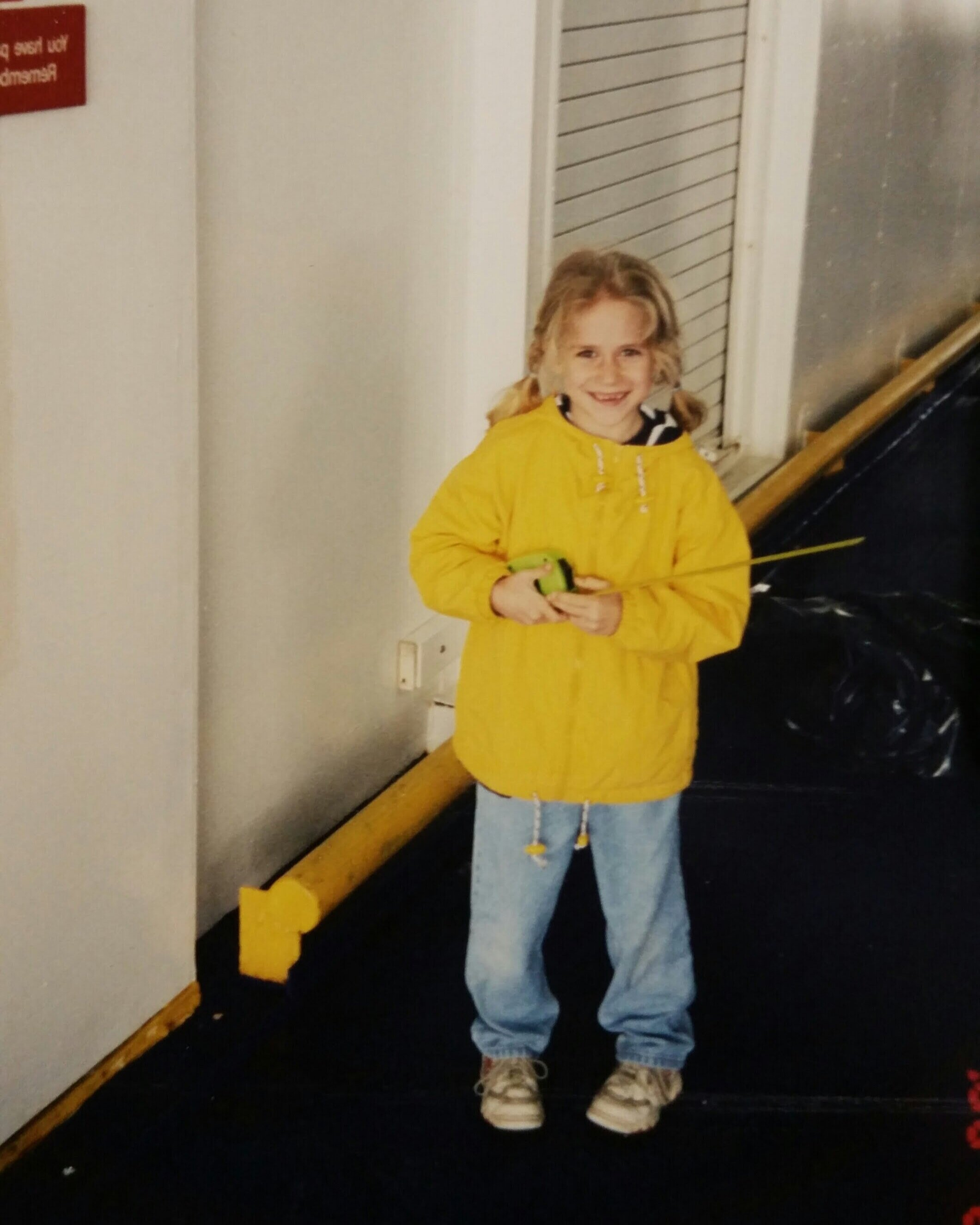 Hannah as a child, about to measure the dimensions of a ship's elevator on her first ship survey with her dad.