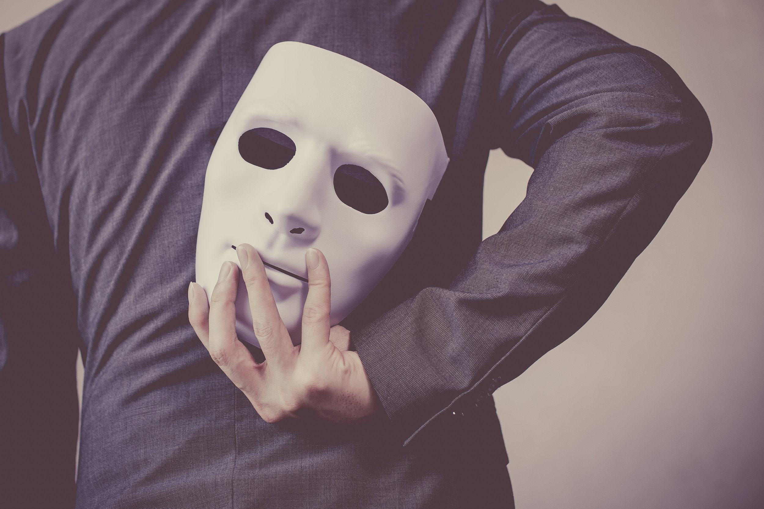 Feeling like you are wearing a mask is all too common, especially when you reach a new level. It is a feeling that can hamper performance.   Photo courtesy: Shutterstock
