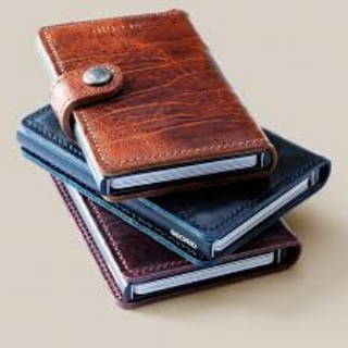 Secrid Wallet  Secrid wallets are small on the outside but surprisingly big on the inside. Designed and made in Holland using traditional methods and locally sourced leather & aluminum, this compact wallet stores up to 6 cards in its RFID protected ultra-thin card chamber. The cards can be viewed and removed easily with the flick of a button. 6 more cards and plenty of cash can be stored in the leather pockets, all securely fastened with a stud closure. This wallet is compact, secure and perfect for someone looking for the latest in wallet tech with old-school style.