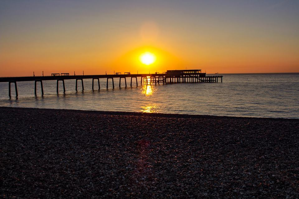 Sunrise over Deal pier by Chris Gisby