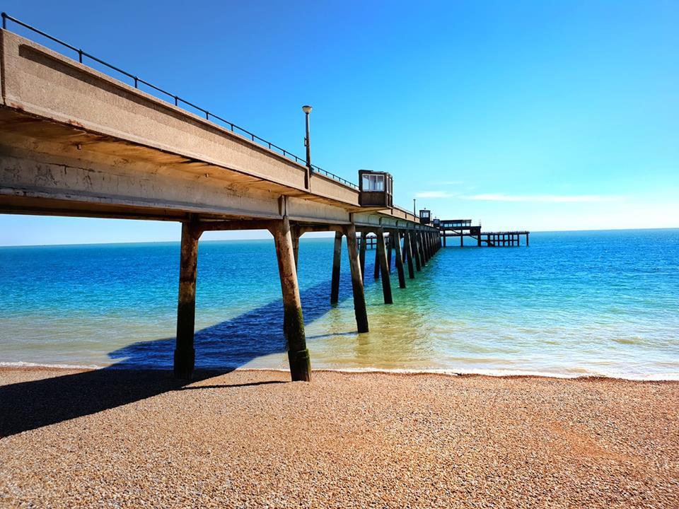 Deal pier at low tide by Darryn Jenner