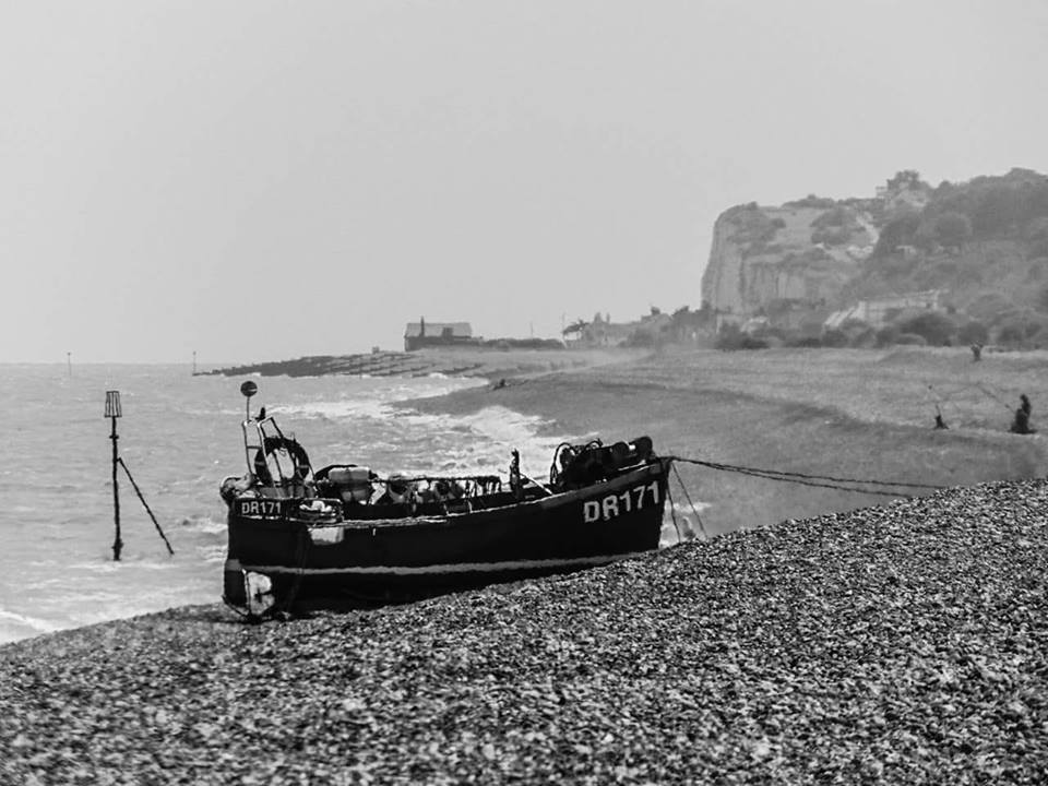 Fishing boat on the beach by Stacy Couchman