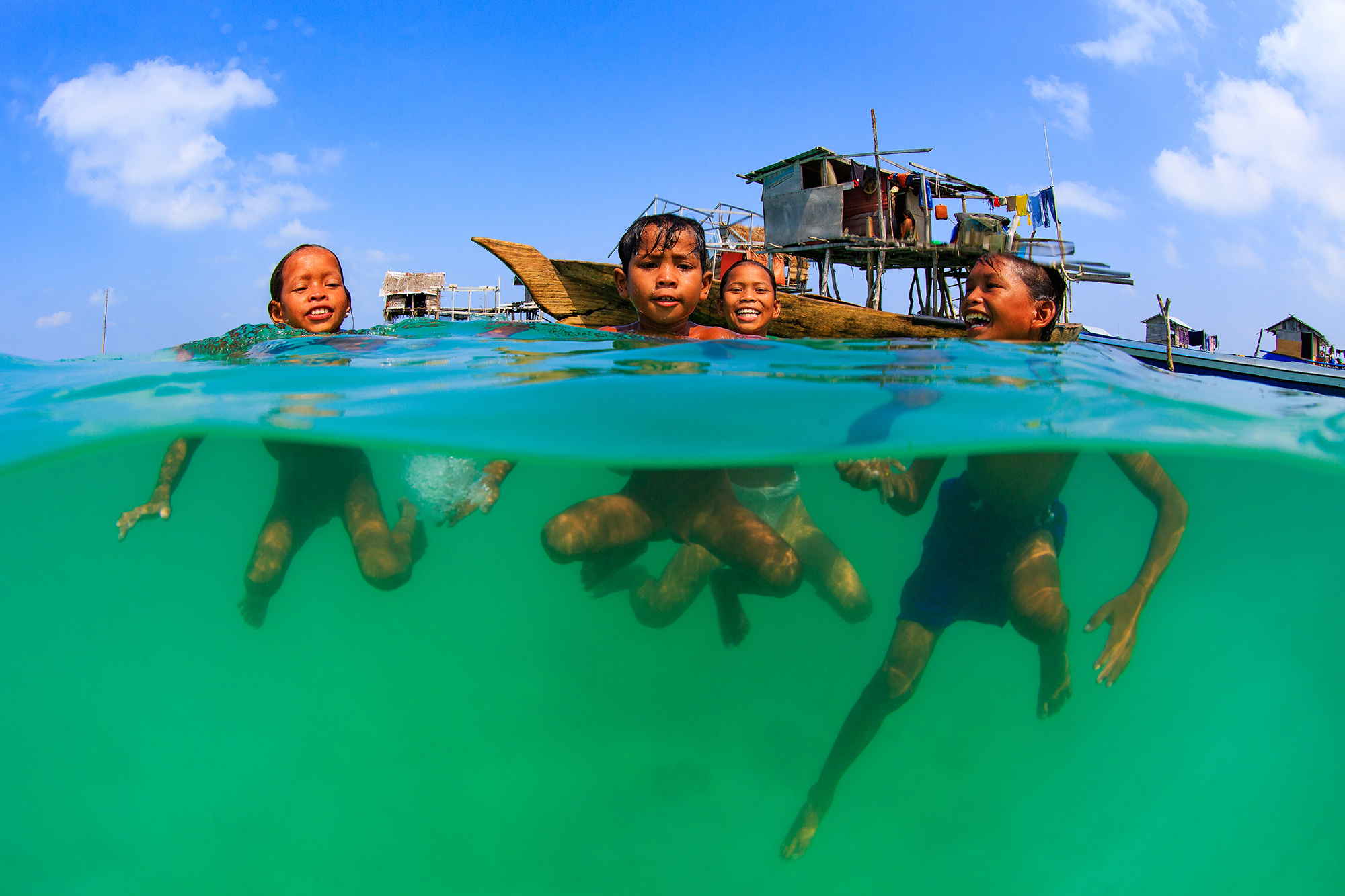LOCALS SWIM IN Semporna, Malaysia CREDIT: YEN-YI LEE / coral reef image bank