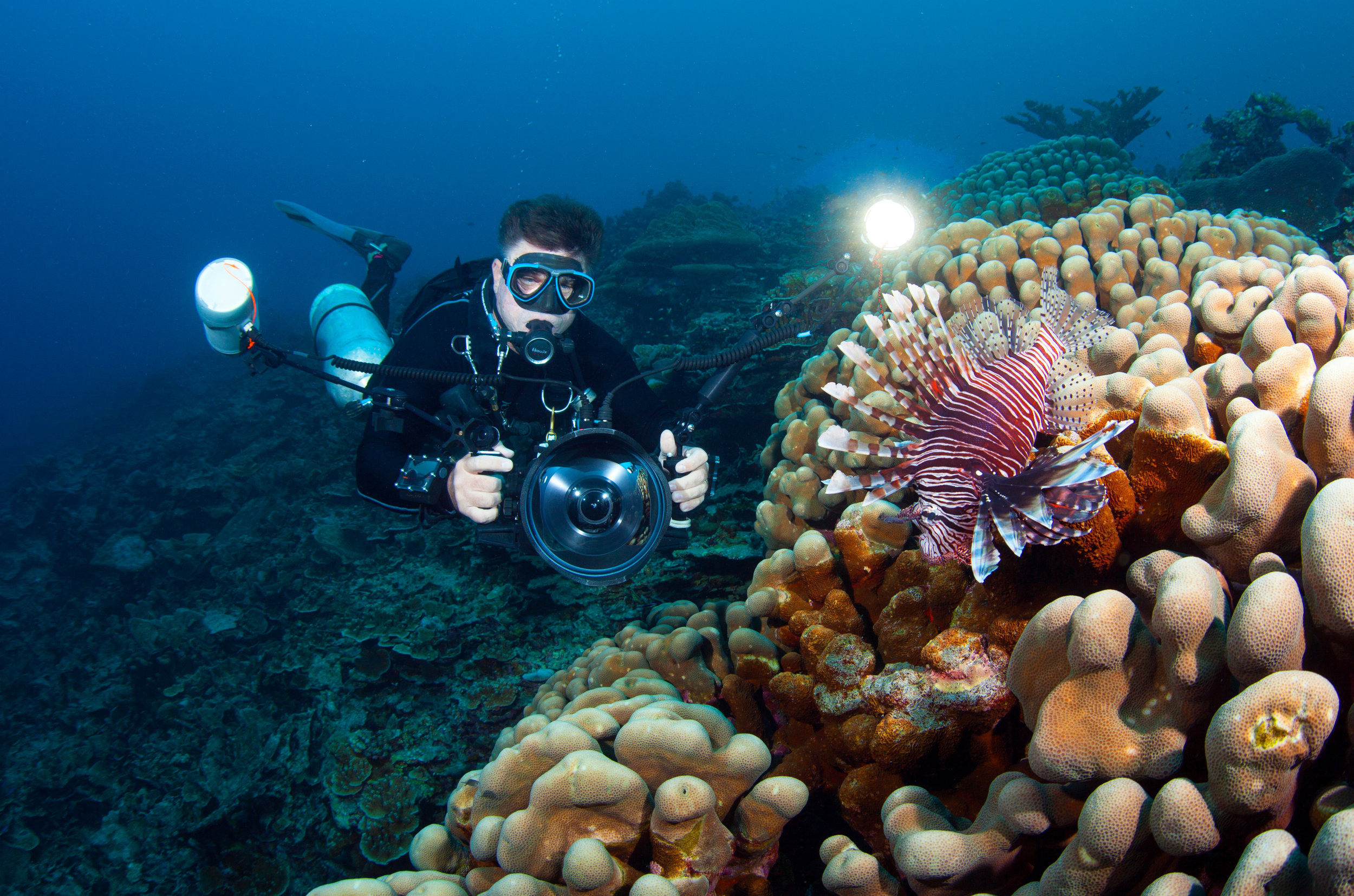 photographing a lionfish on Christmas Island CRedit: Jill heinerth / coral reef image bank