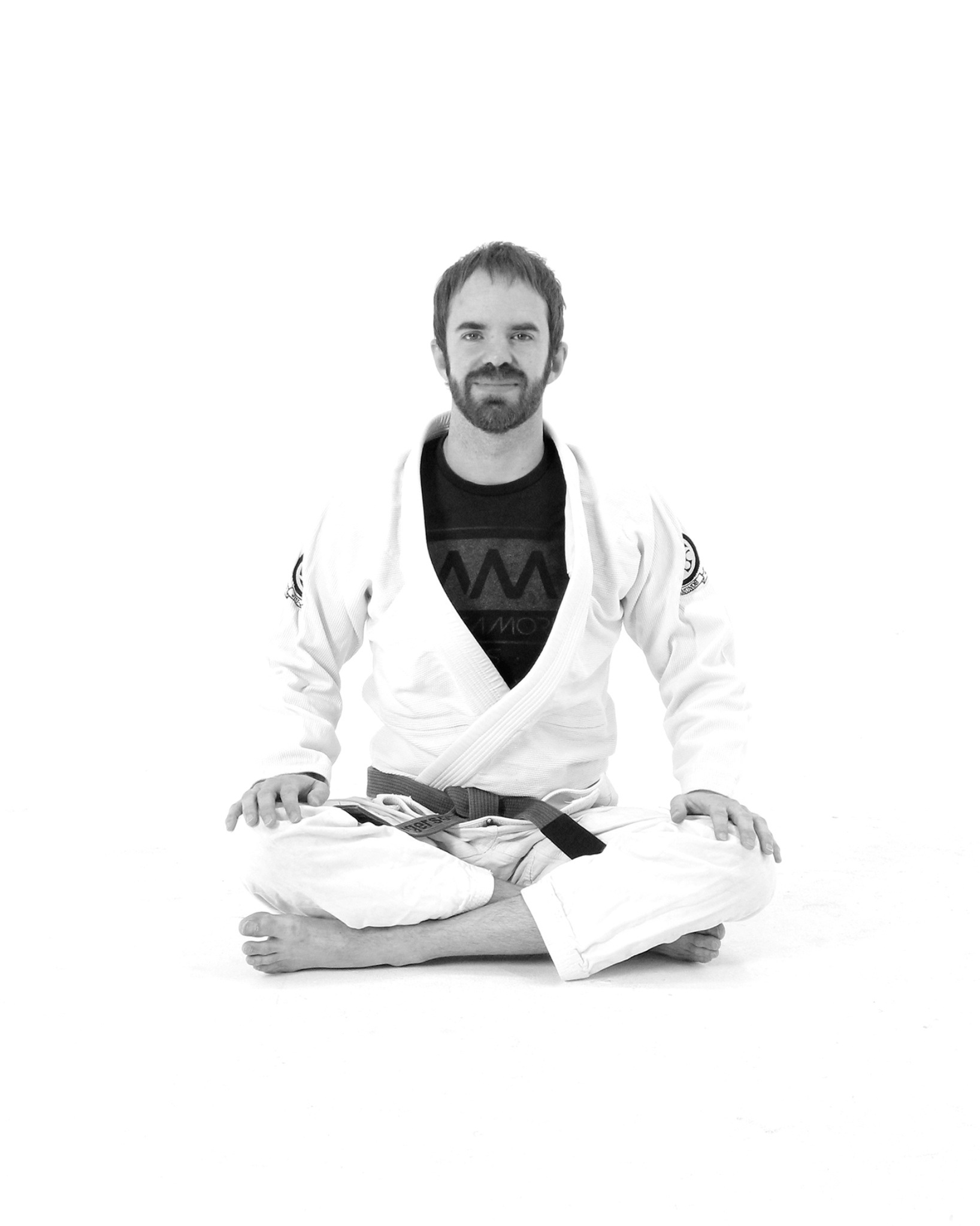 Bryan Gregerson - Bryan Gregerson, co-owner of Clube LA with his wife Nancy, began training Jiu Jitsu in 2001 at the age of 15. By 16, he had earned his blue belt from Rigan Machado and Paulo Guillobel. Bryan left the mats for ten years to concentrate on earning his Bachelor's and Master's degrees at the University of Southern California.After some prodding from his high school students at Mendez High School in Boyle Heights, Bryan returned to training to teach an after school self-defense class. He is now a brown belt and the Fundamentals instructor at Clube Los Angeles.Bryan's beginner-friendly approach to teaching is driven by his understanding of various learning theories he studied while earning his Master of Arts in Teaching (MAT) degree at USC and by his eight years' experience teaching Social Studies in the Los Angeles and Boyle Heights. Bryan is (almost!) fluent in Spanish.