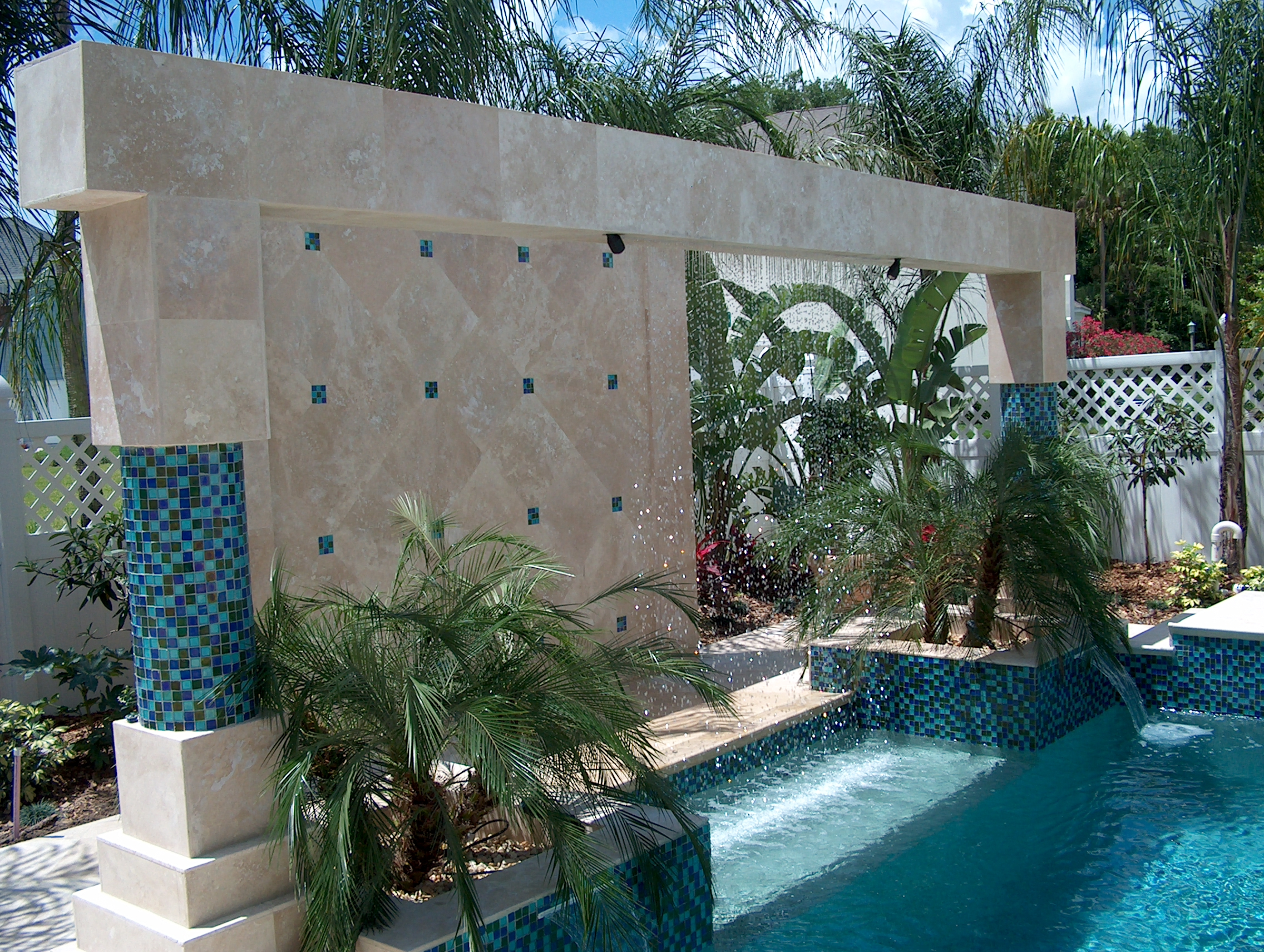 Rain Curtain with Travertine & glass tile, LED Lights.jpg