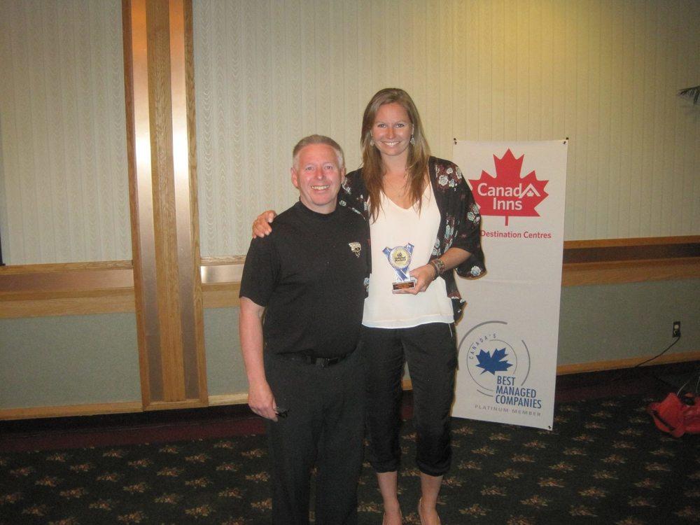 Ken Bentley presenting the Manitoba Volleyball Association Hall of Fame Award.