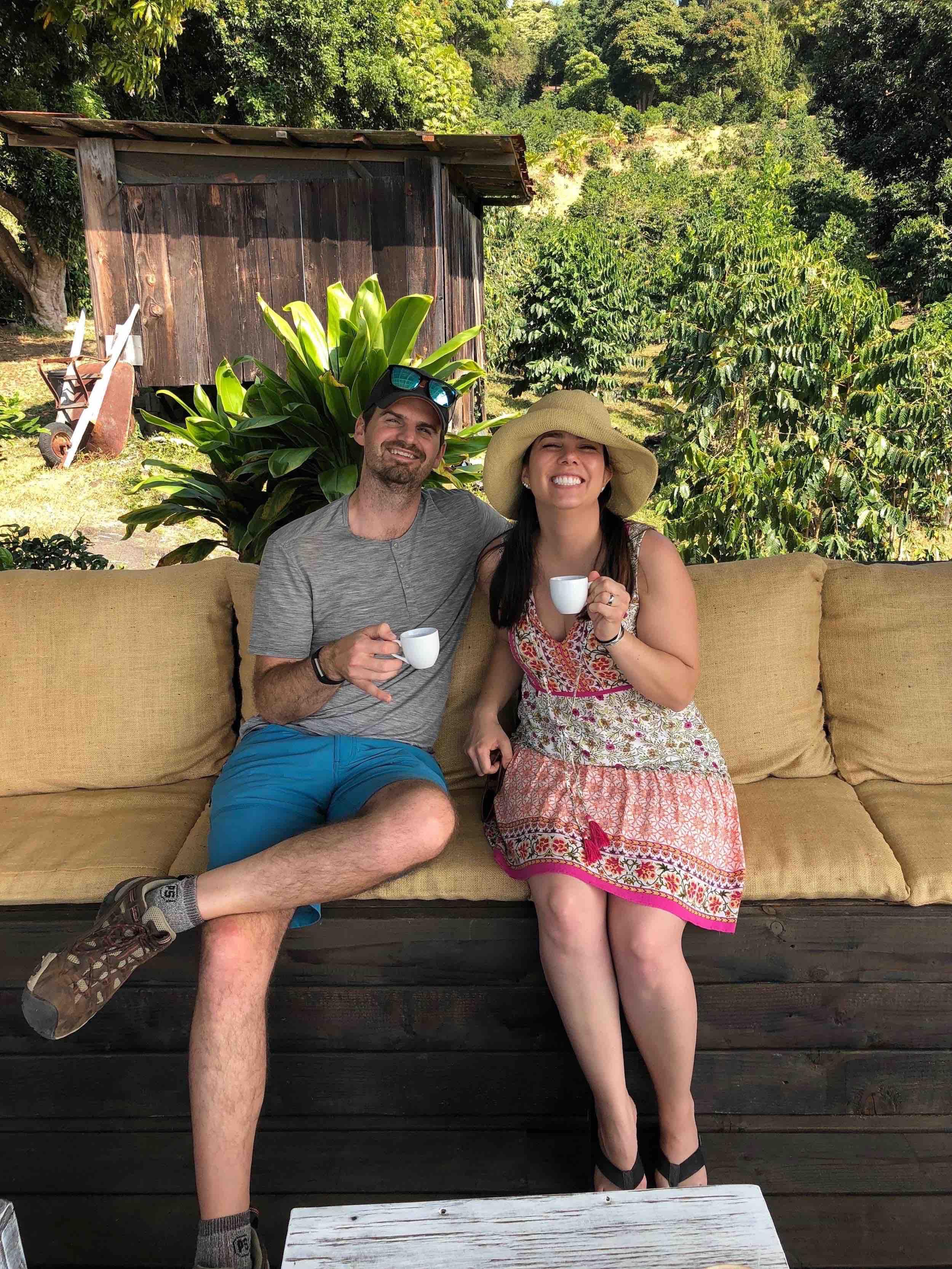 Couple enjoys Kona coffee tasting at Hala Tree in Kona, Hawaii.