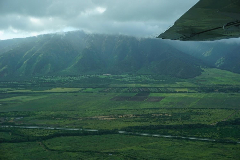 Flight soaring through the hilltops of Maui, Hawaii. boldlygotravel.com
