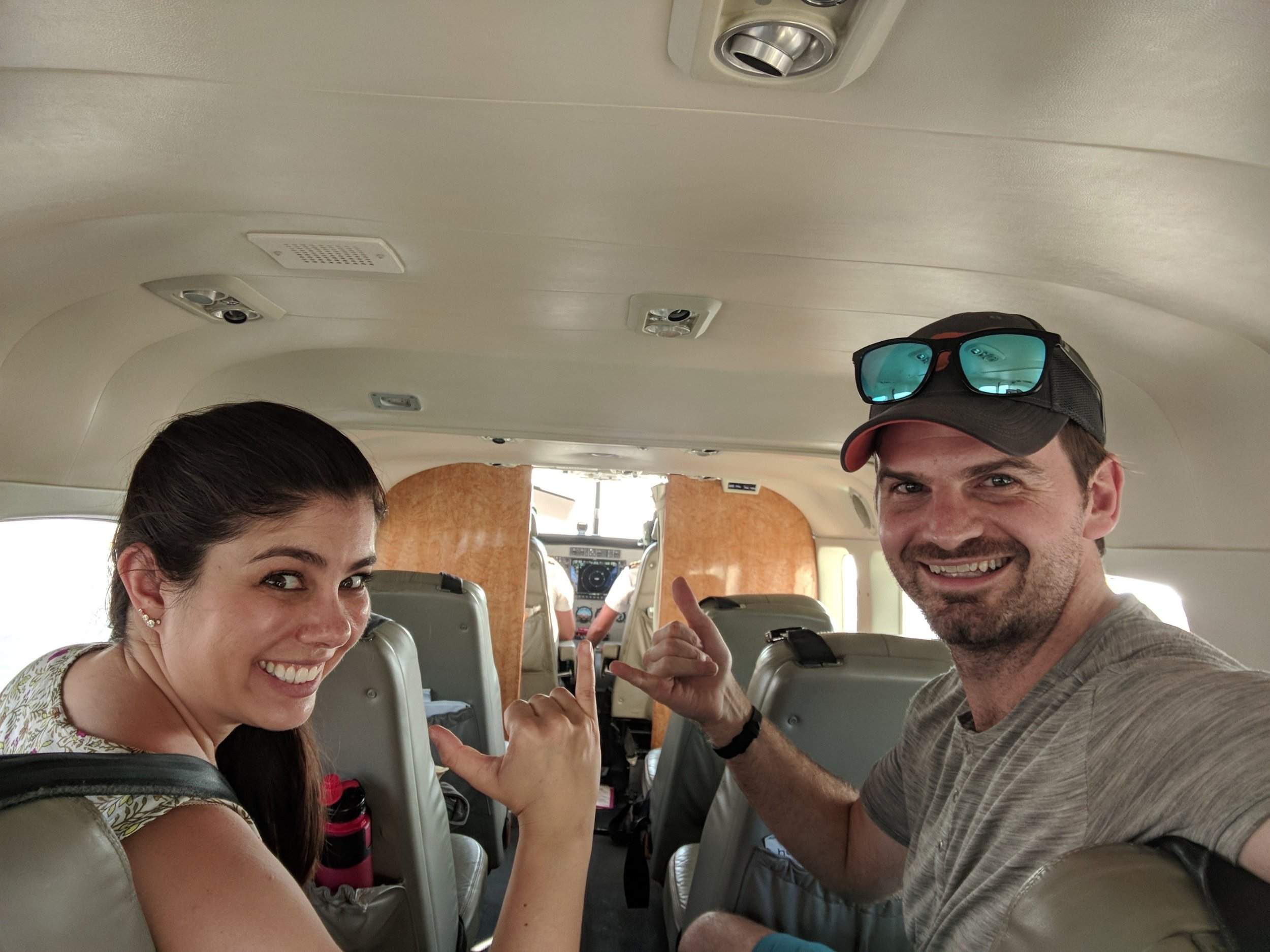 couple has the whole plane to themselves as the fly to Maui, Hawaii. boldlygotravel.com