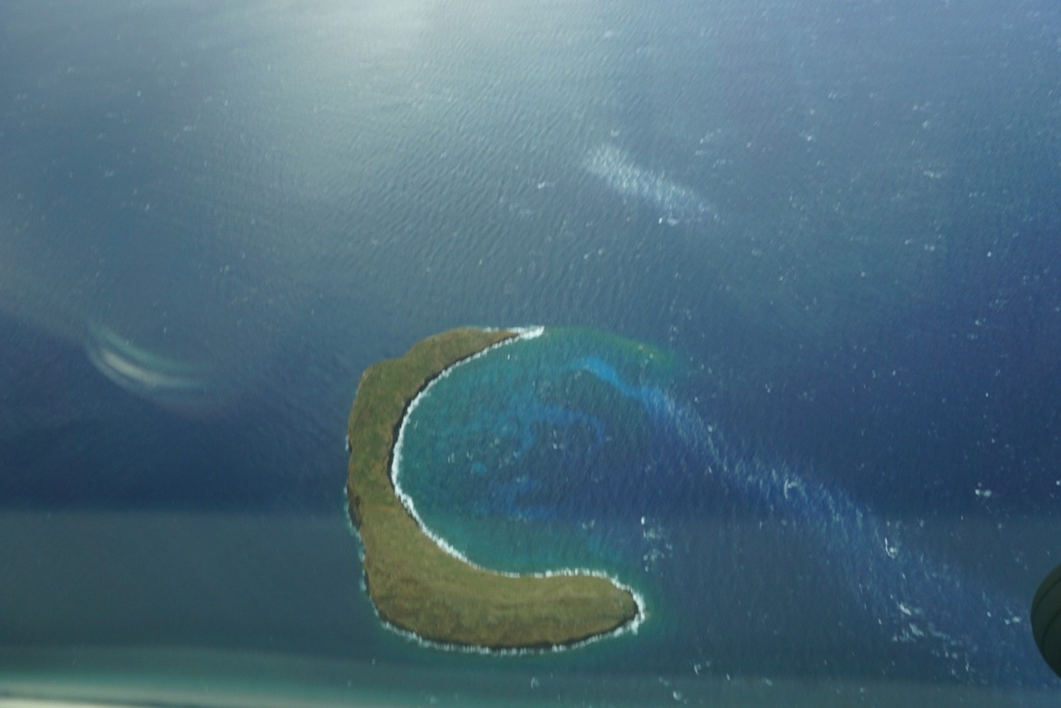 View of Molokini crater from a plane, Maui. boldlygotravel.com