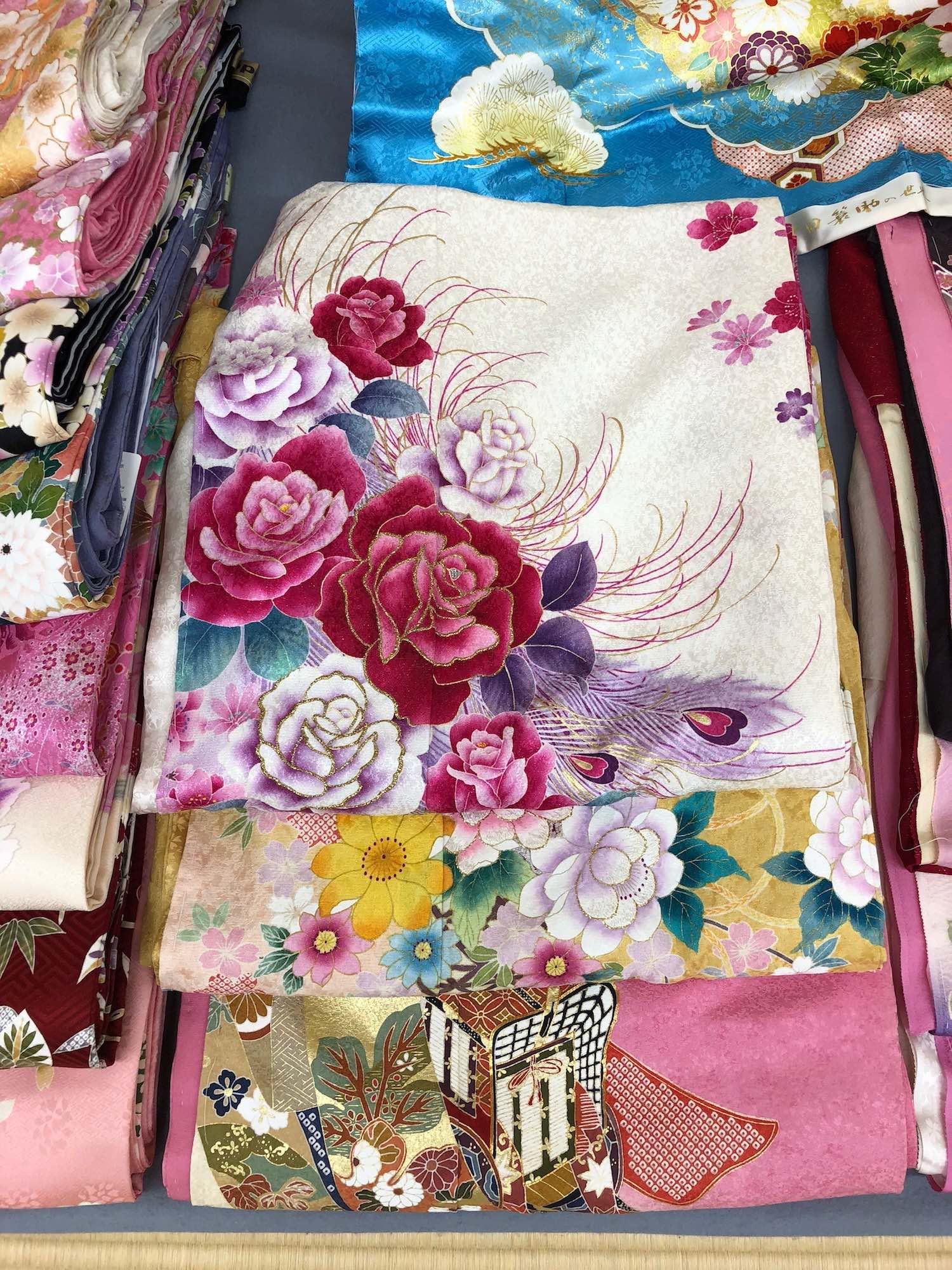 Beautiful silk kimonos on display at shop in Kyoto, Japan. boldlygotravel.com