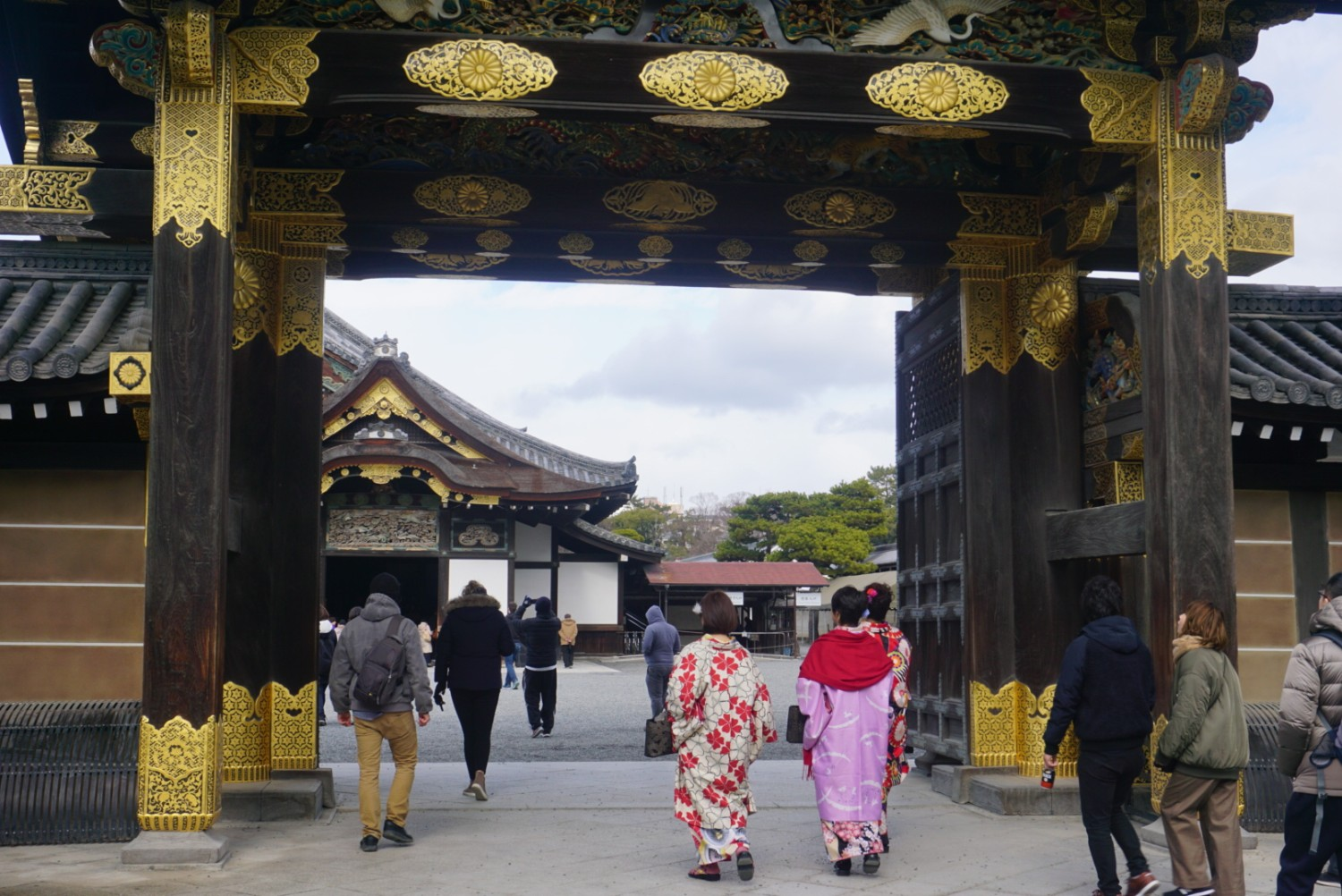 Nijo Castle is where the Shogun would work and reside, women dressed in traditional geisha enter along with the other tourists in Kyoto, Japan. boldlygotravel.com