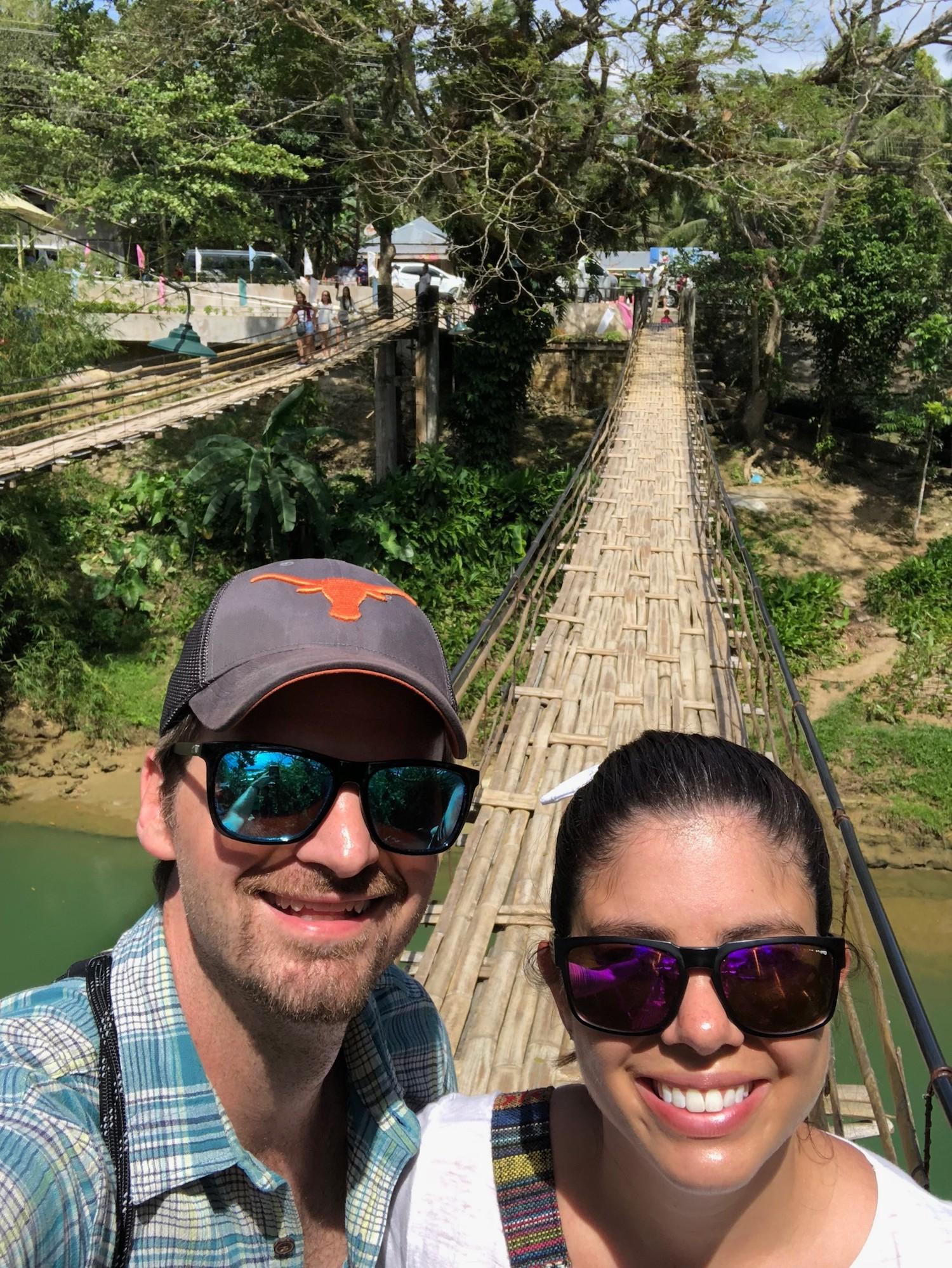 Matt and Kelly on bamboo suspension bridge in Bohol, Philippines.