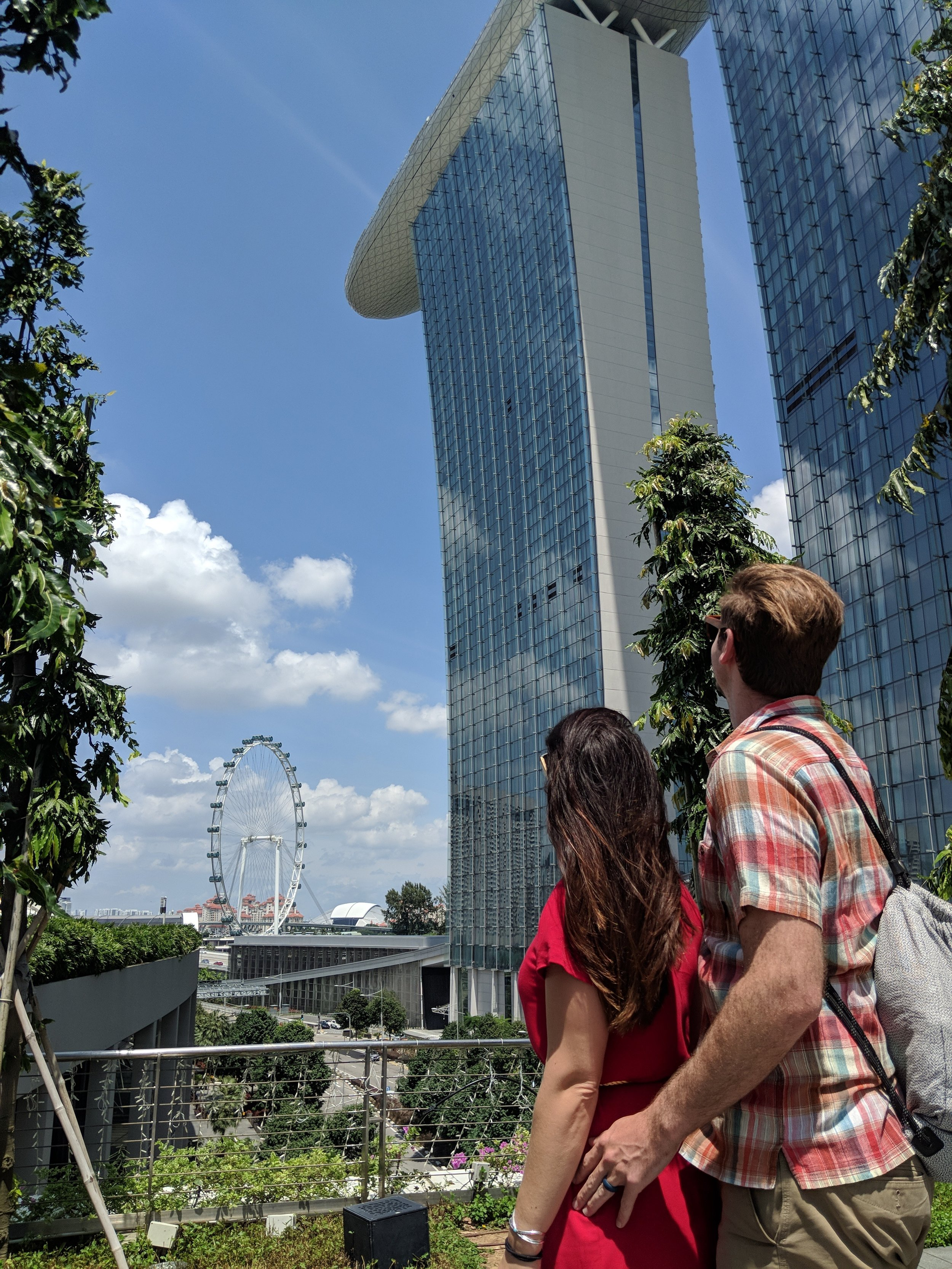 Couple stares at the grand Marina Bay Sands Resort in Singapore. boldlygotravel.com