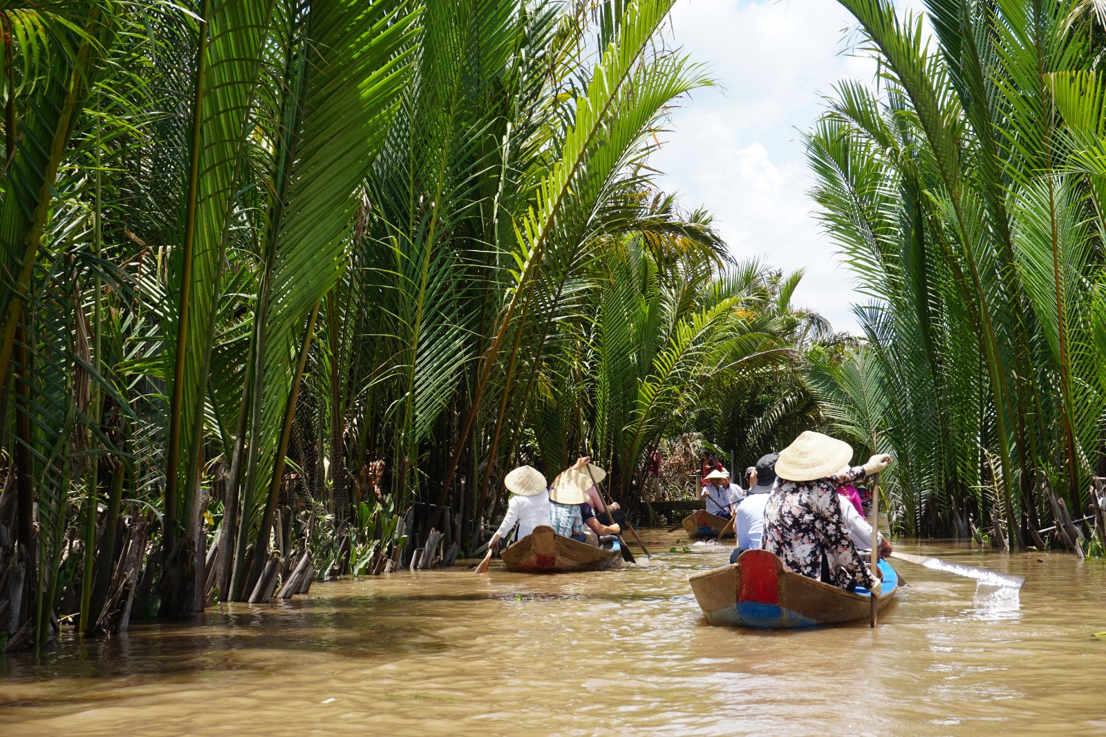 Floating down the Mekong River, Vietnam in traditional canoes. boldlygotravel.com