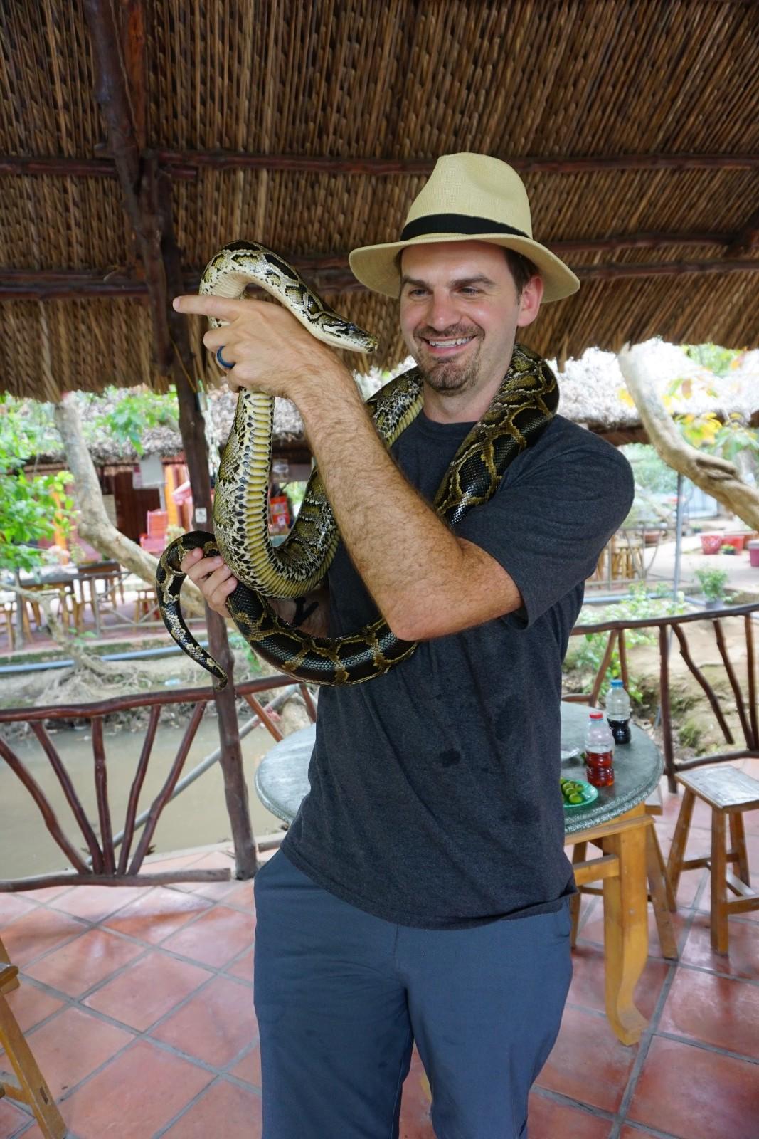 Matt Holds Snake in Mekong Delta Tour