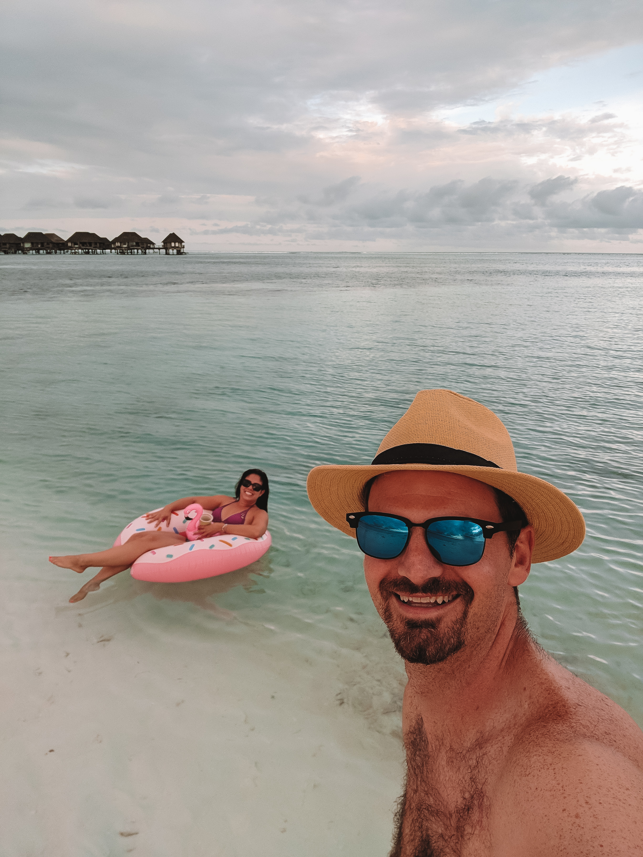 Kelly and Matt enjoy the Maldives on a local island with some fun pool floaties. boldlygotravel.com