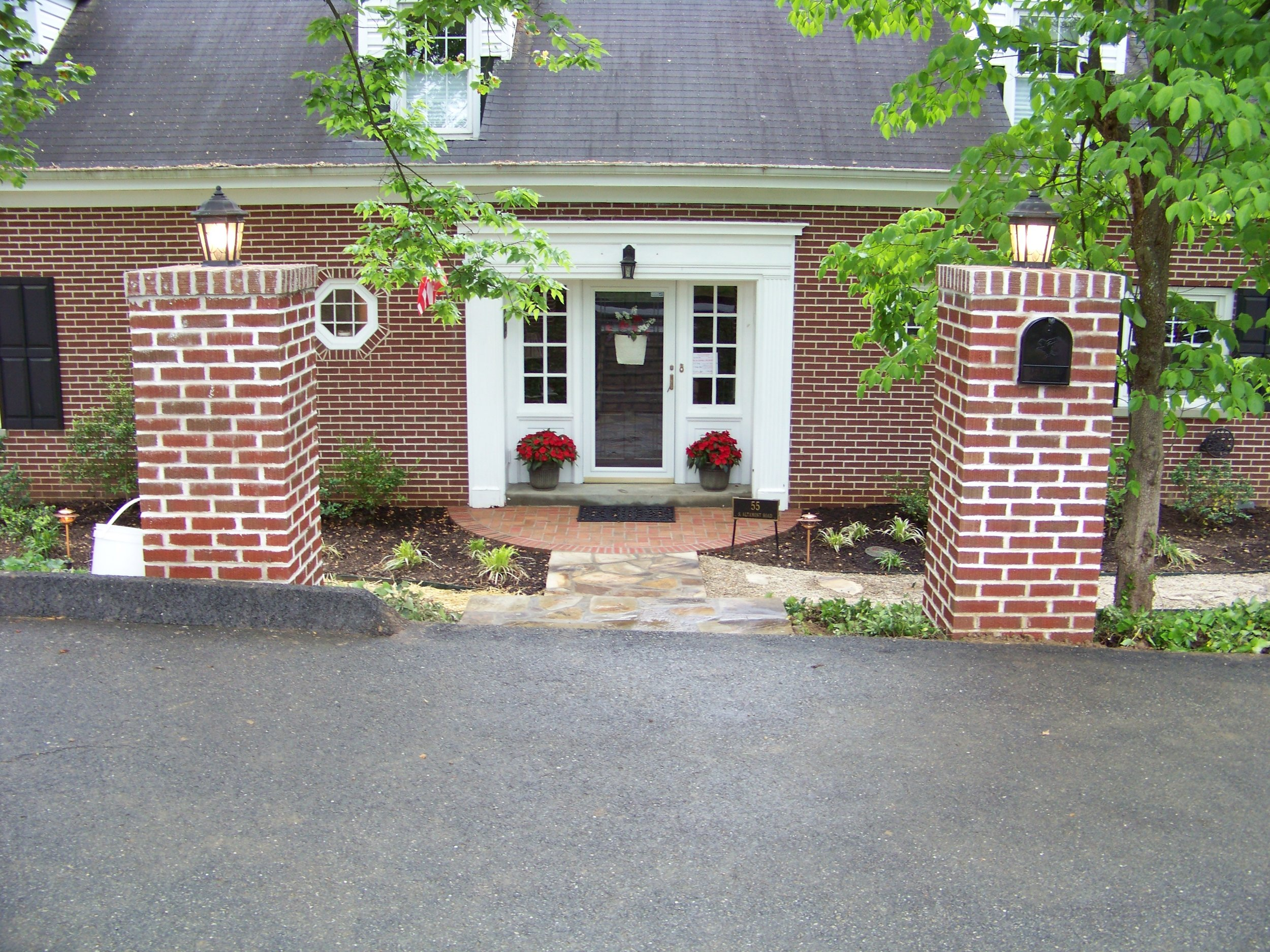Brick columns, flagstone walk and entrance