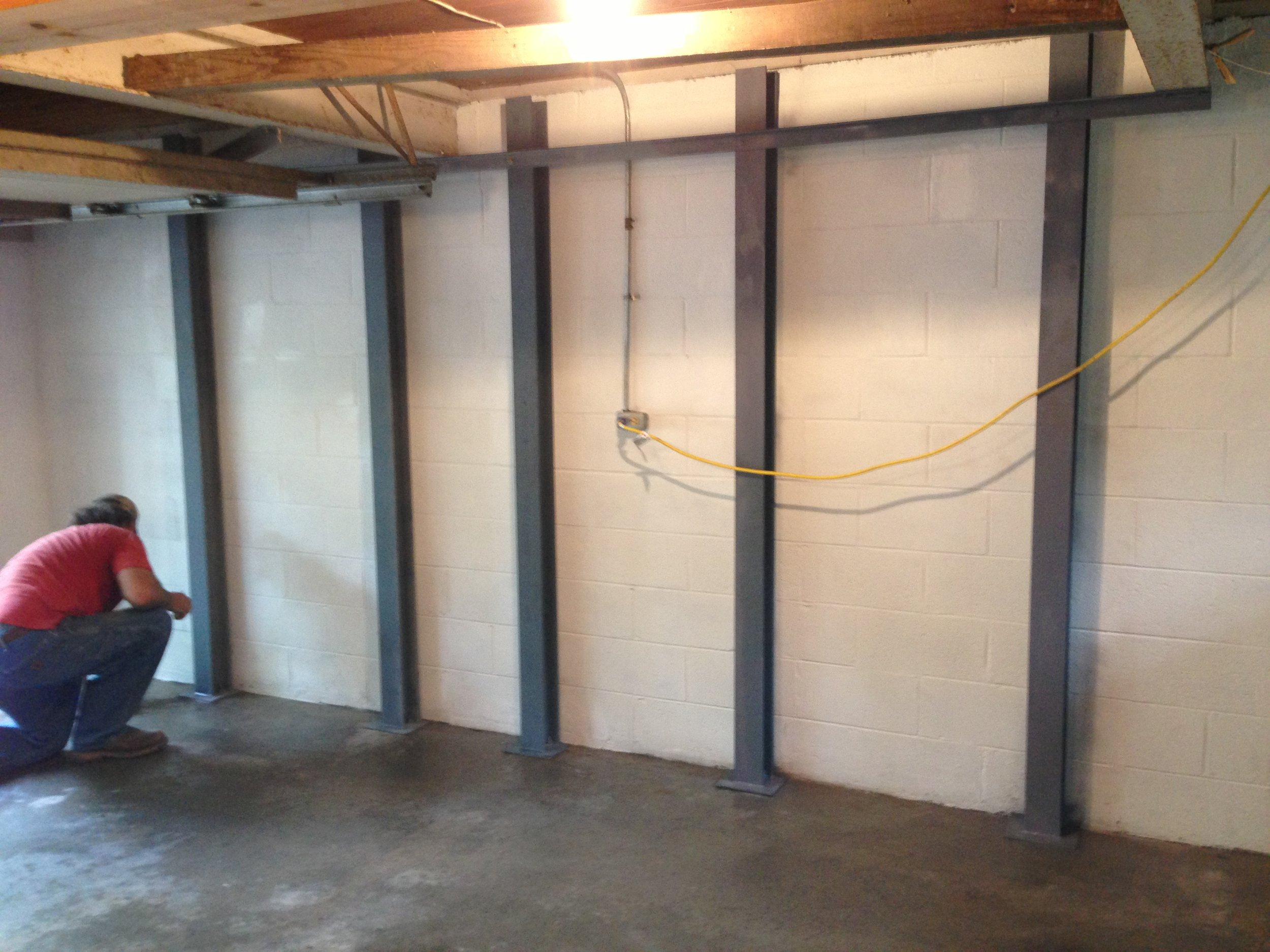 Basement wall stabilization, steel buttresses