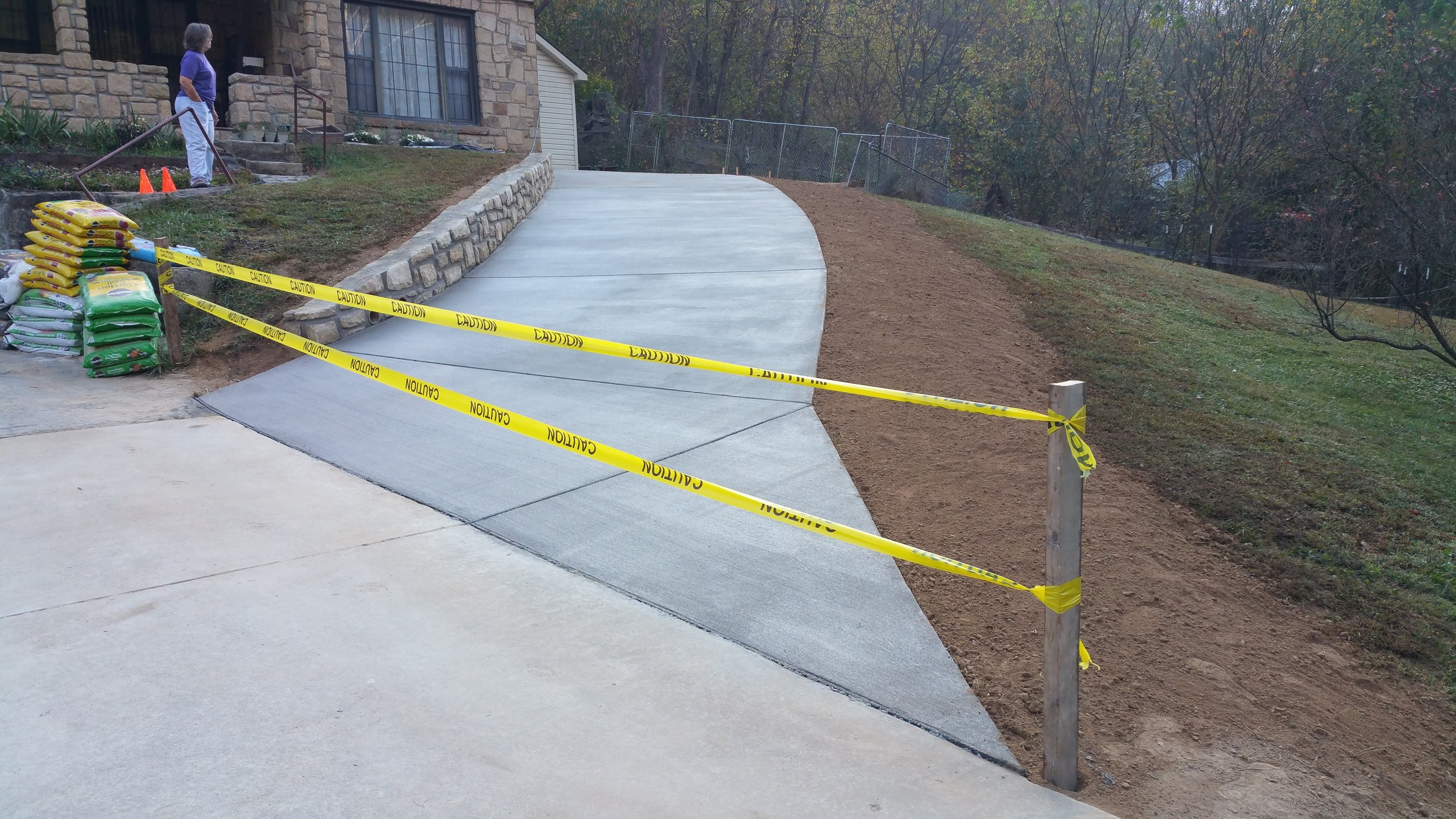Concrete driveway and stone retaining wall