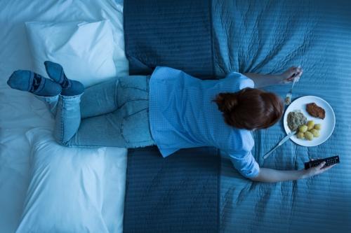 iStock-eating on bed.jpg