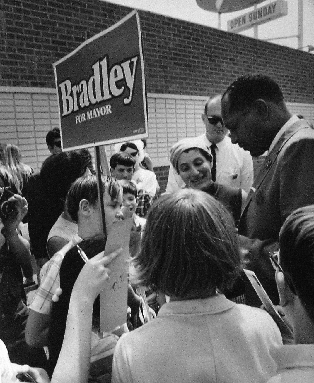 6.-L.A.-City-Councilman-Tom-Bradley-campaigning-for-Los-Angeles-mayor-in-1969---Photo-credit-to-the-Tom-Bradley-Family-copy.png