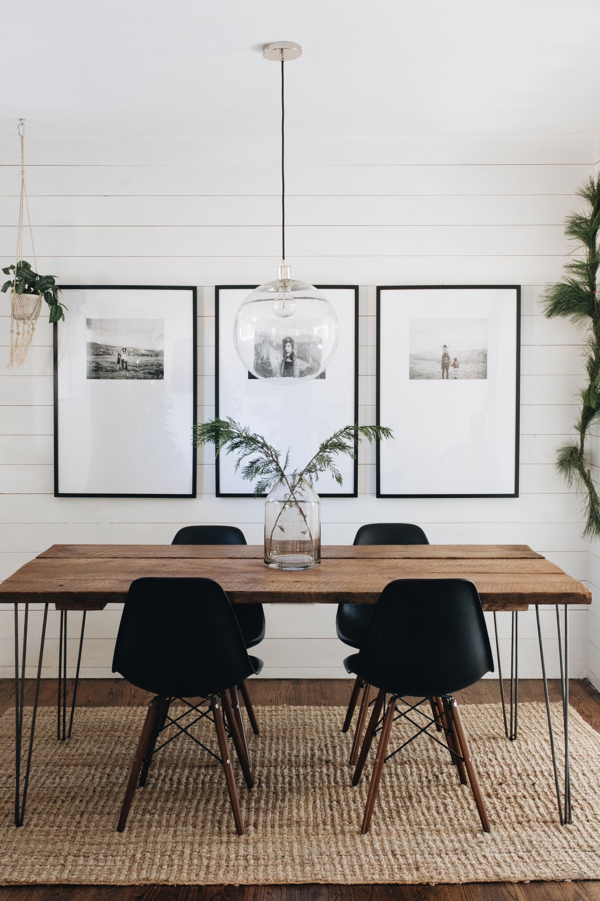 Three black and white photos in large mats and black frames for minimalist dining room decor - how to display art in your house - Leah E. Moss Designs