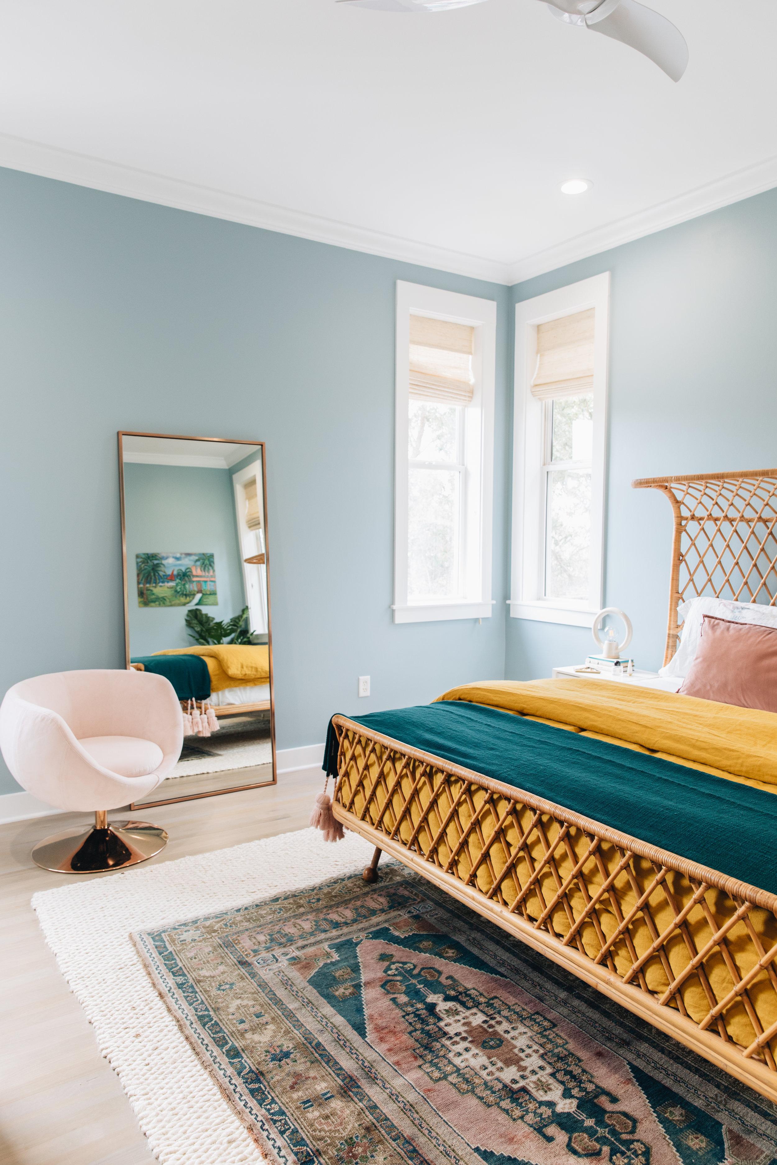 Rattan Bed    Linen Duvet    Velvet Body Pillow    Floor Mirror    Pink Chair    White Jute Rug
