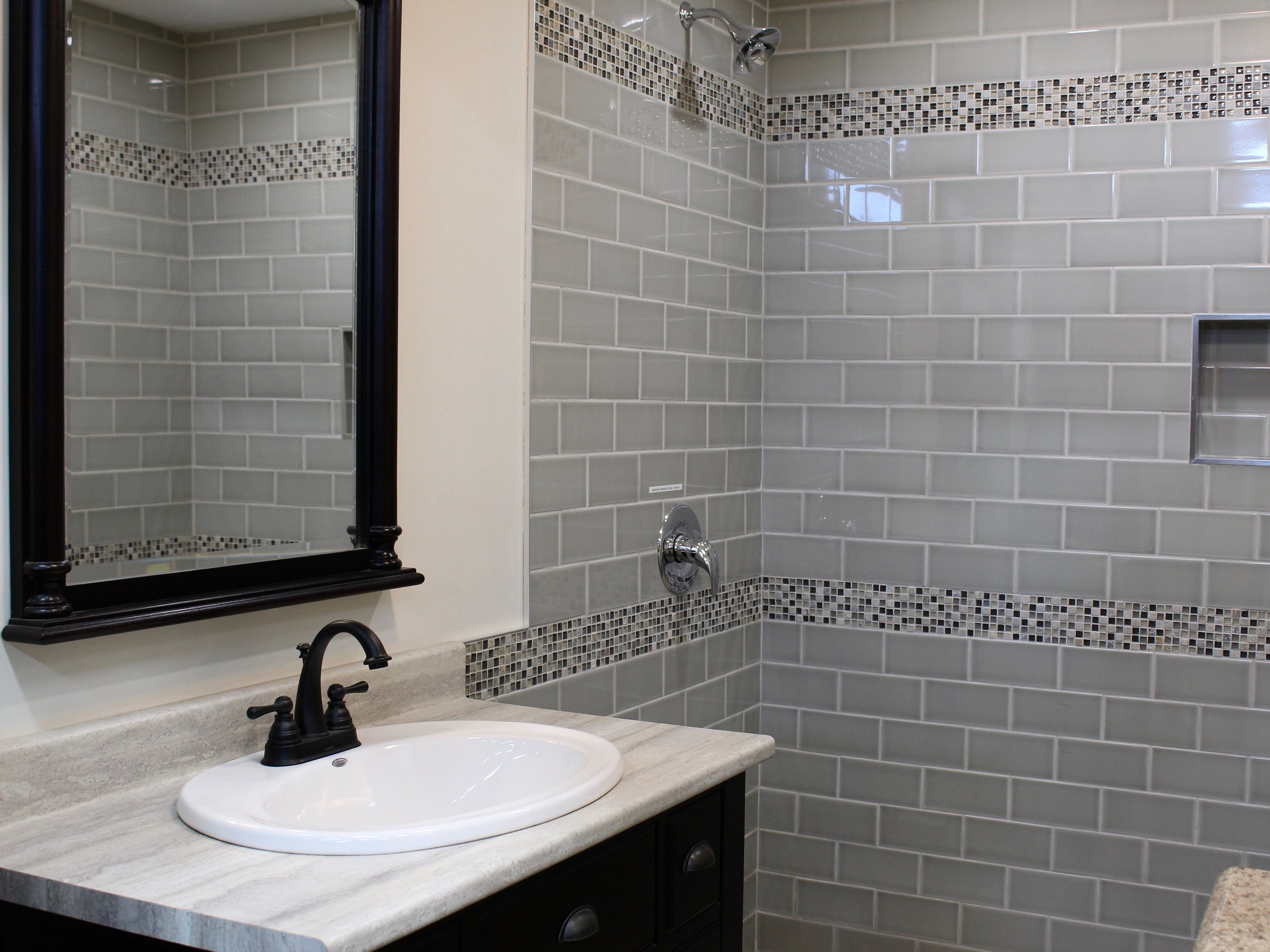 Bathroom with subway tile and mosaics