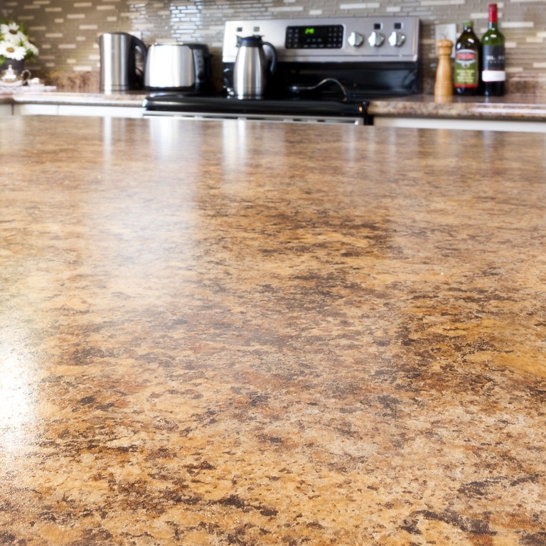 LAMINATE - Laminate countertops come in a variety of different colours, patterns, and edges.  We carry many countertops in stock for you to choose from.  Our countertop cutting saw is on-site for a prompt cut to suit your needs, often able to be ready within 24 hours of your purchase.