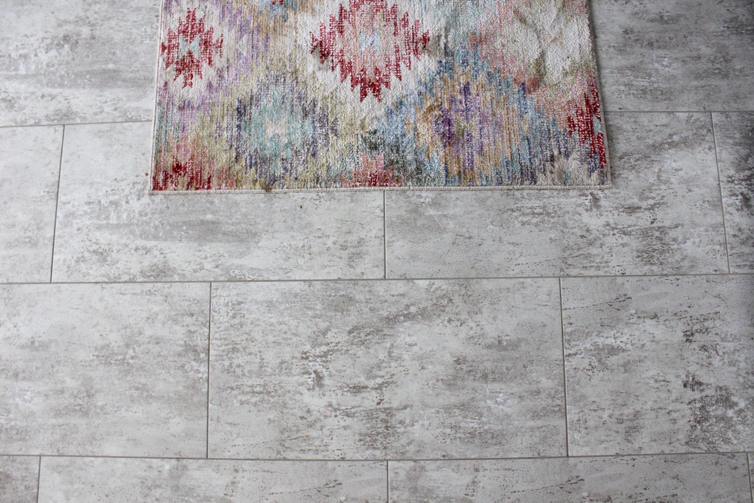 Vinyl tile-look grouted flooring