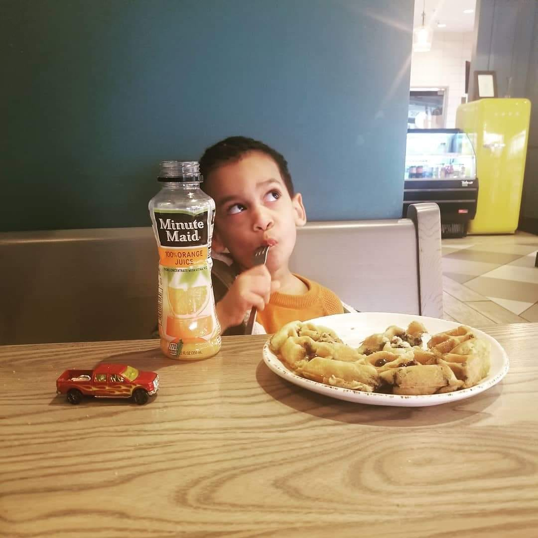 My son eating an adult sized waffle. I probably wrote an email two minutes after this was shot.