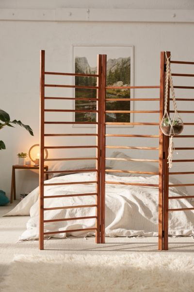 Divide + conquer the smallest of spaces with this hinged tri-panel room divider in a ladder design you can hang towels, clothing, accessories + even plants from!
