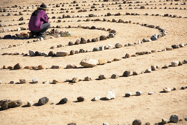 A visitor in the center of the Joshua Tree labyrinth