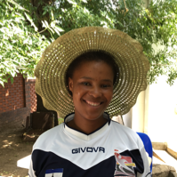 """Palesa Emely Pitso - Palesa (""""Rose"""") started rugby in 2015, and currently plays front row in the women's league with the Maseru Warriors. Rose loves it when the school children chant """"rugby! rugby! rugby!"""" and run towards the car when the LRA coaches arrive."""