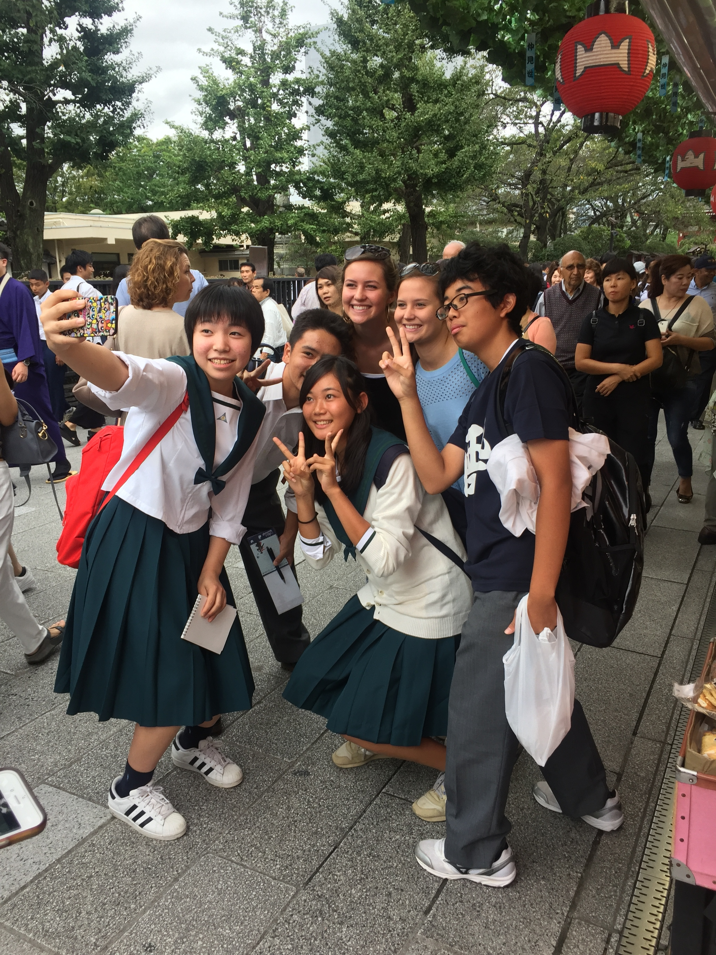 Christi & Kayla take a few minutes to have their pictures taken with Japanese school kids